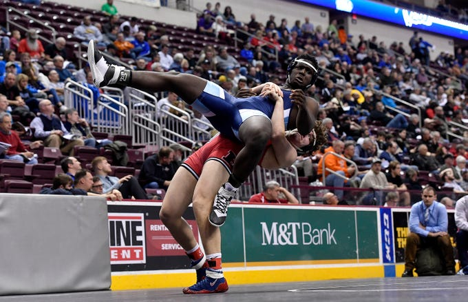 Dallastown's Jamal Brandon is slammed to the mat by Andrew Balukas of Easton during the PIAA Class 3-A 220 , pound first round match, Thursday, March 7, 2019.John A. Pavoncello photo