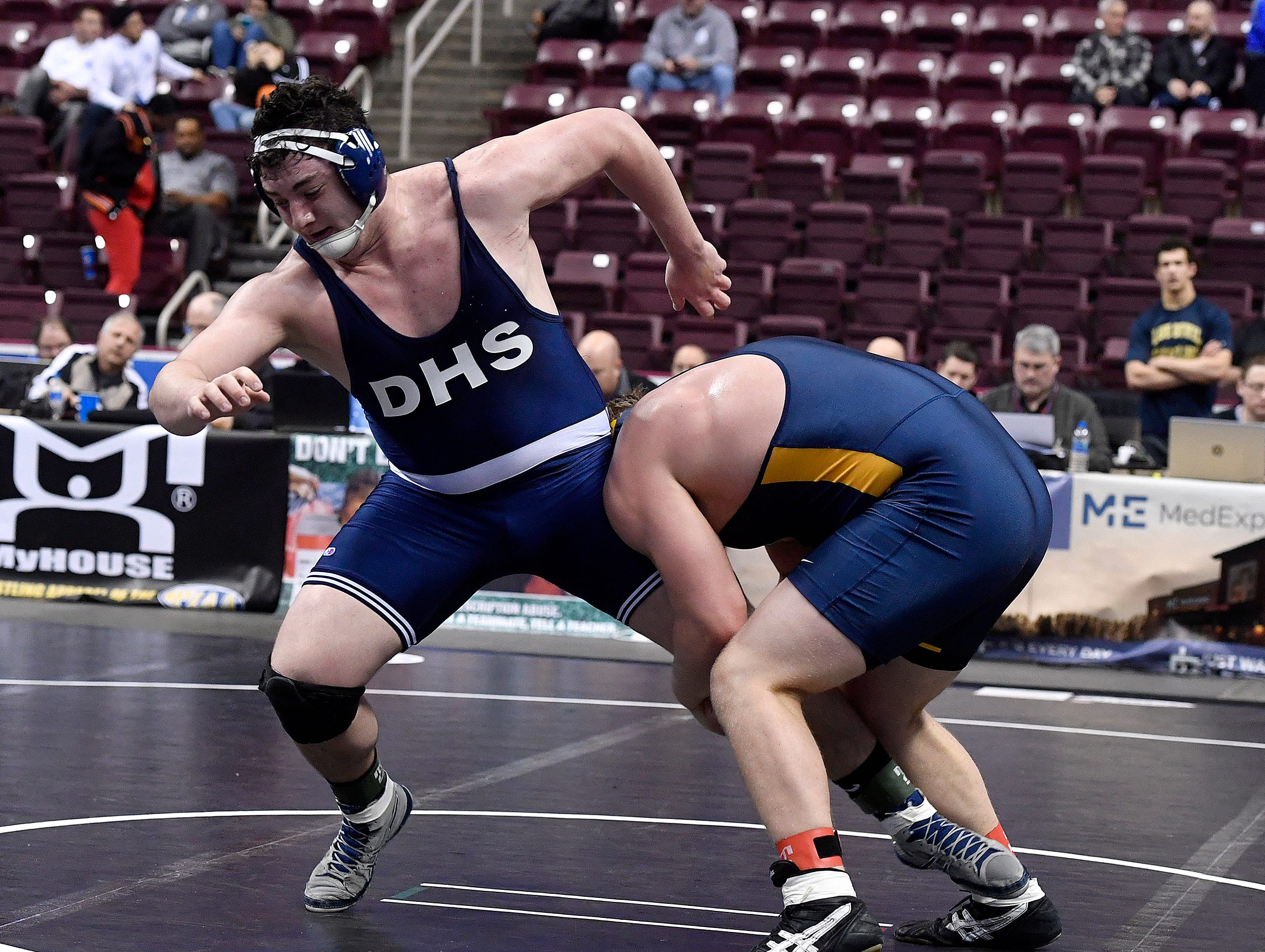 Raymond Christas of Dallastown struggles for an escape  from Nathan Hoaglund of Mt. Lebanon during the PIAA Class 3-A 285 pound first round match, Thursday, March 7, 2019.John A. Pavoncello photo