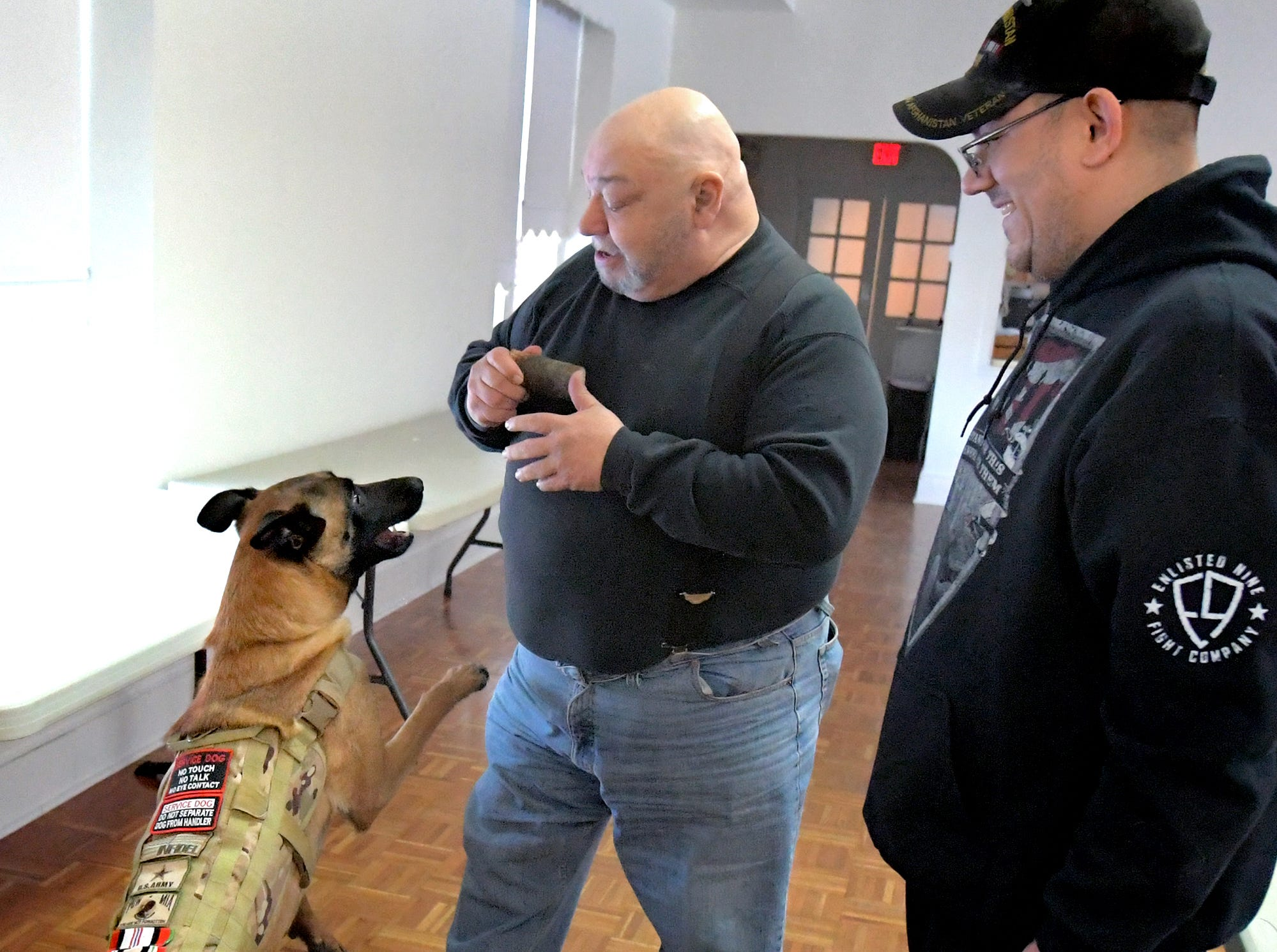 "Bob Fink, left, works with Robert McCready Jr's Belgian Malinois Sheep Dog ""Maxine"" during a training session at Trinity Lutheran Church in East Berlin Thursday, March 7, 2019. Fink was leading a session offered by Cover Six Canines, a ministry of Freedom Biker Church York, which gives free service dog training to veterans. McCready lives in Camp Hill. Bill Kalina photo"