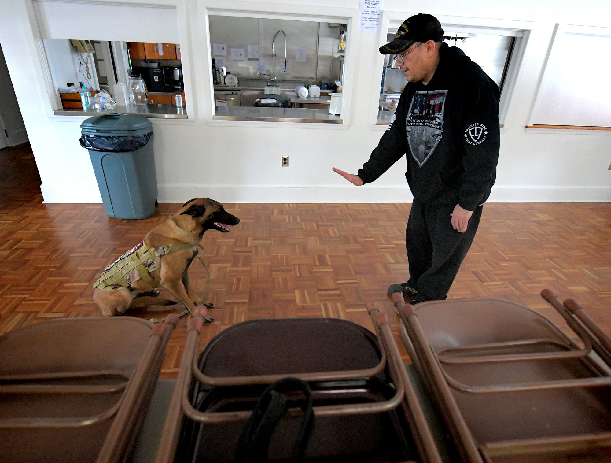 "Robert McCready Jr. of Camp Hill talks to his Belgian Malinois Sheep Dog ""Maxine"" during a training session at Trinity Lutheran Church in East Berlin Thursday, March 7, 2019. He was participating in a session offered by Cover Six Canines, a ministry of Freedom Biker Church York, which gives free service dog training to veterans. Bill Kalina photo"