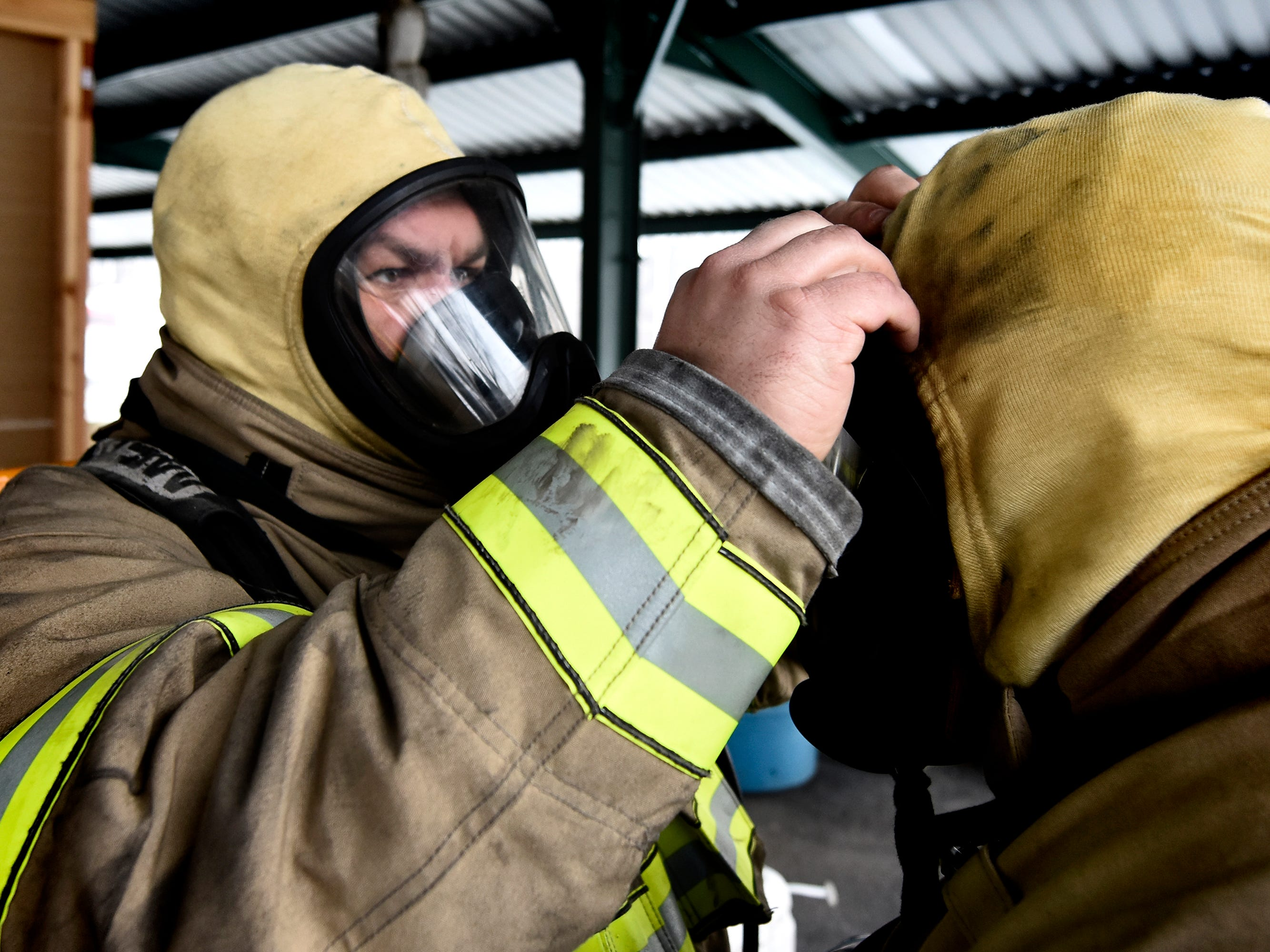 York County Prison Sergeant Jeff Baldwin, left, helps Sergeant James Benn with his gear while preparing for a fire scenario at the York County Fire School during training there Friday, March 8, 2019. Members of the prison's 30-member Fire Emergency Response Team were completing a 40-hour fire training course at the school. The FERT team is designed to control fire emergencies onsite prior to the arrival of firefighters. Bill Kalina photo