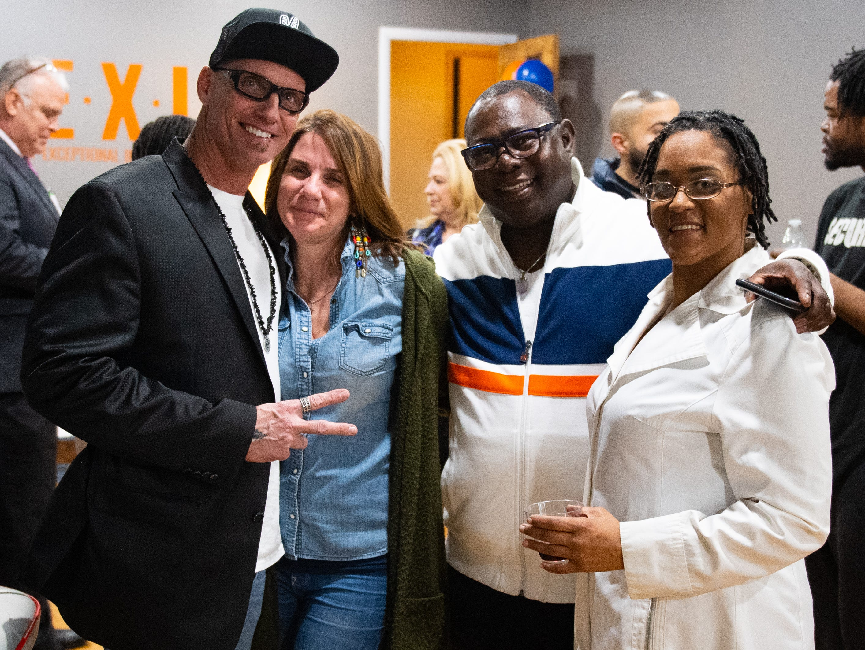 (Left to right) Tracey Young, Sher Young, Michael Breeland and Faith Holy are all smiles during the Jook Joint Global Inc. and LEXI Social Club grand opening, March 7, 2019.