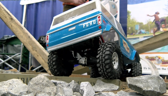 A remote-controlled 4x4 truck runs through the Blue Rocks Family Campground obstacle course at the York  RV Show at the York Expo Center on March 8, 2018.