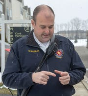 York Area United Fire and Rescue Battalion Chief Joe Madzelan describes the approximate shape and size of the piece of metal that went through the roof of a townhouse in Spring Garden Township on Friday, March 8, 2019.
