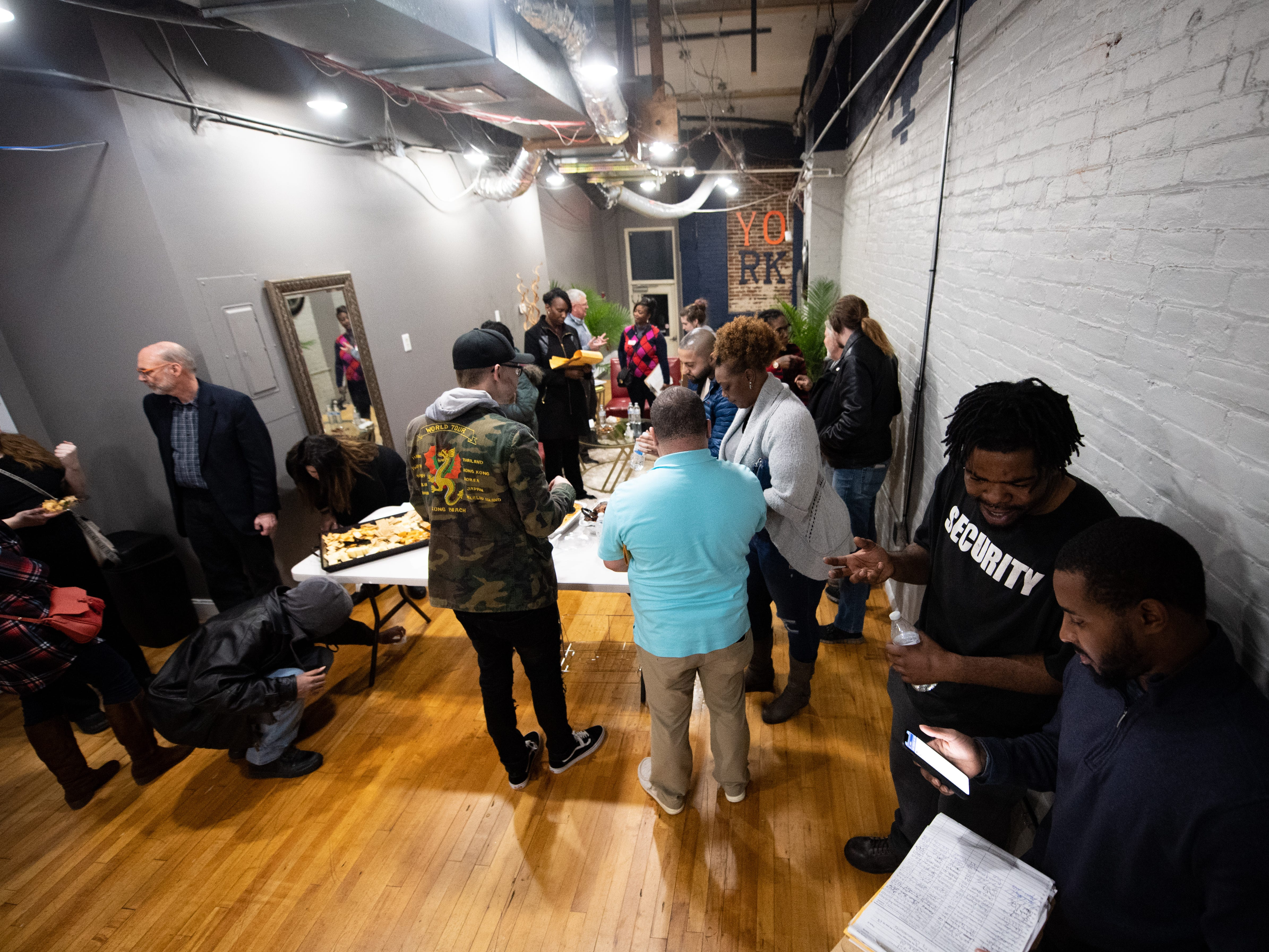 The grand opening party for the Jook Joint Global Inc. and LEXI Social Club is filled with community leaders, friends family, students and Cornbread West lovers alike, March 7, 2019.