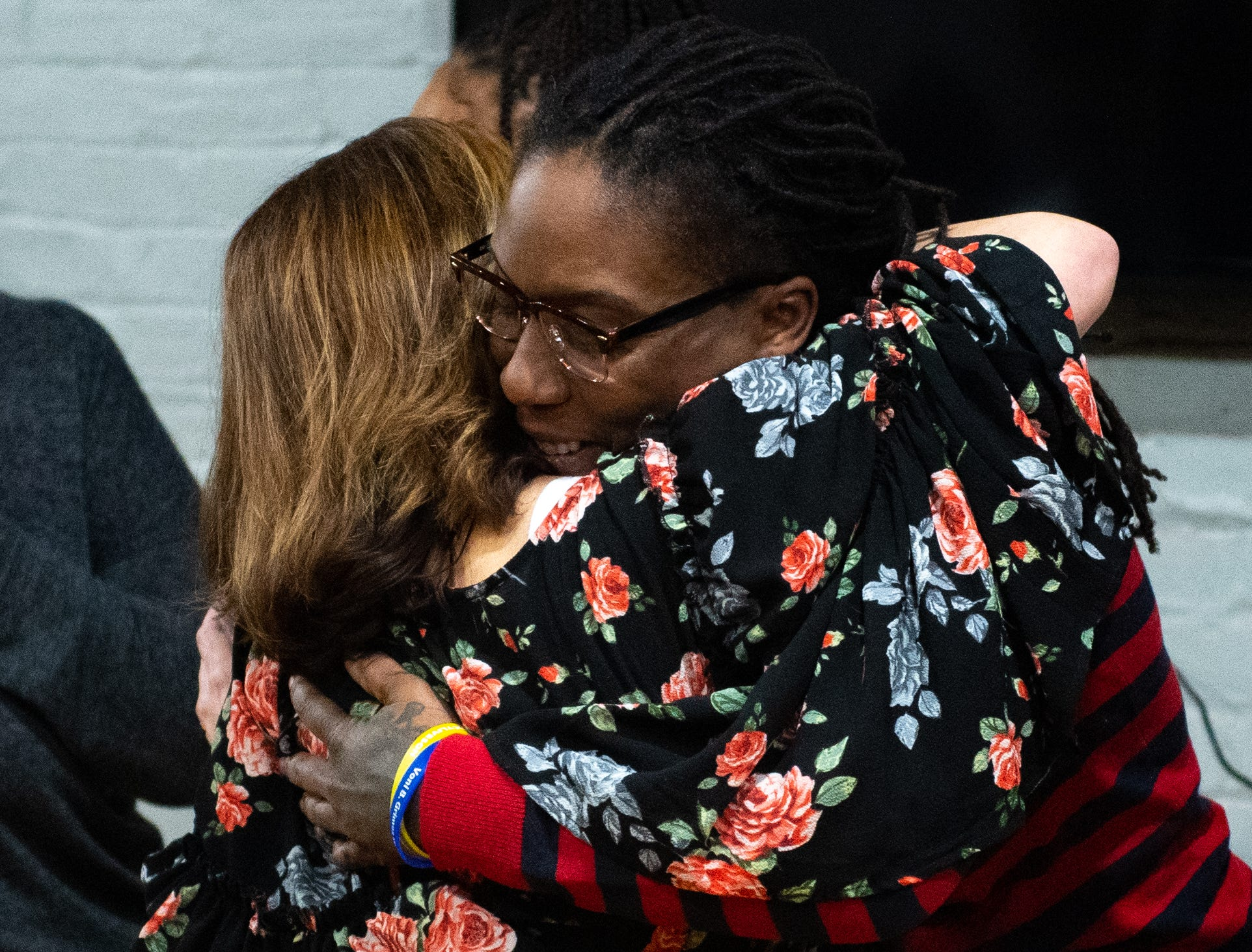 April Collier hugs supporters after her speech thanking the community for all of the help they've given her, March 7, 2019.