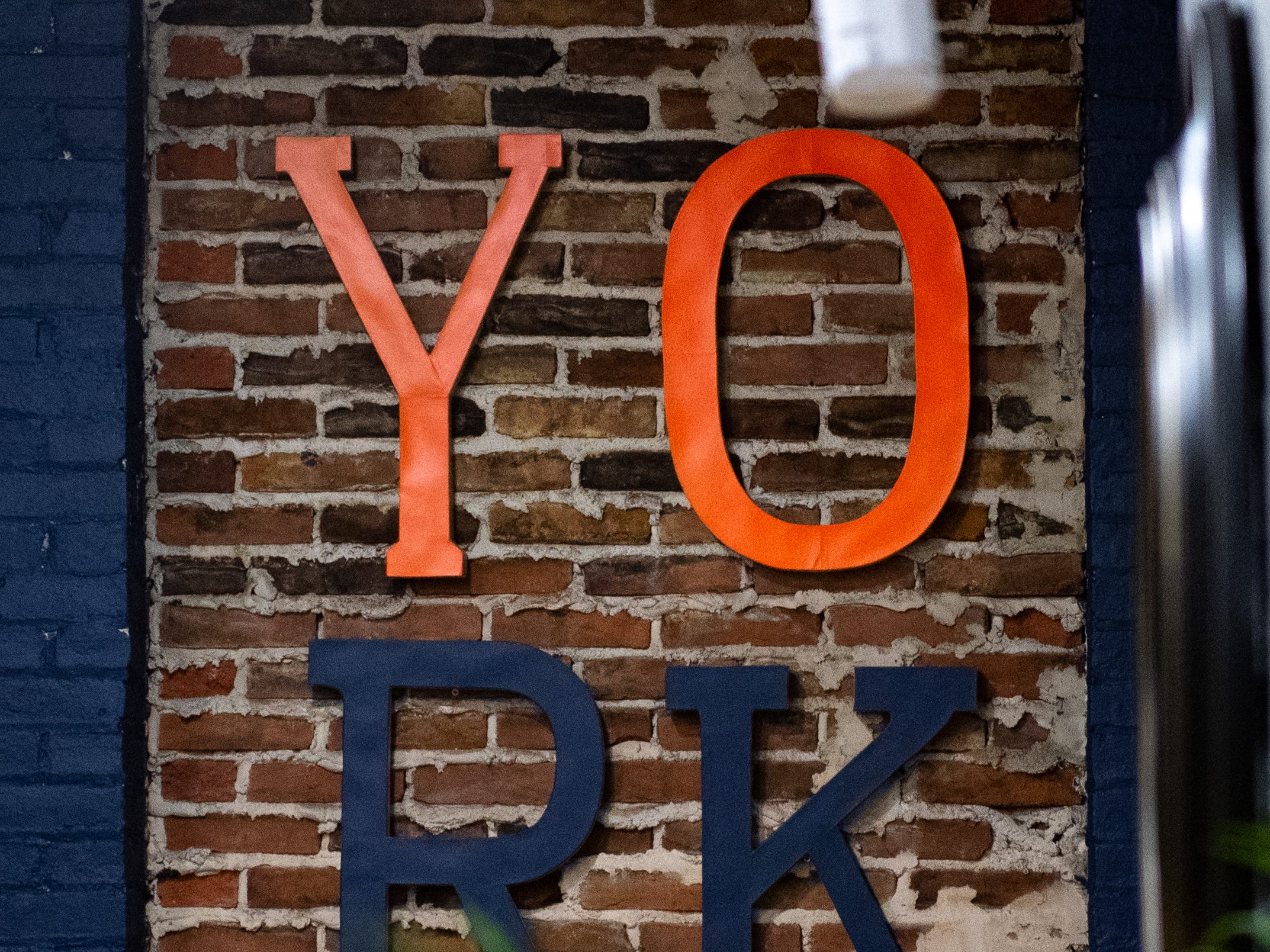 On the back wall of the LEXI Social Club sits a York sign, March 7, 2019.