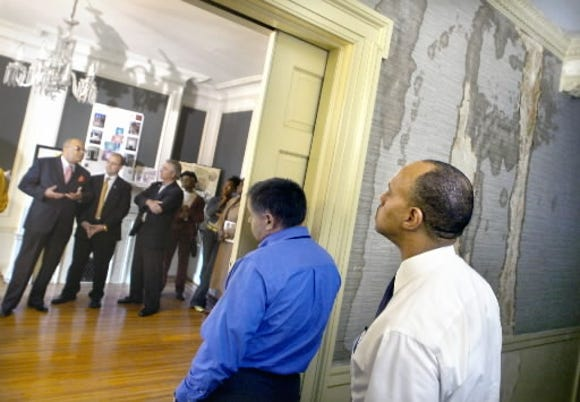 Wm. Lee Smallwood, left, discusses plans for the William C. Goodridge Freedom House and Underground Railroad Museum in 2005. The first phase of the work on the East Philadelphia Street historic site addressed structural issues to help prevent further deterioration.