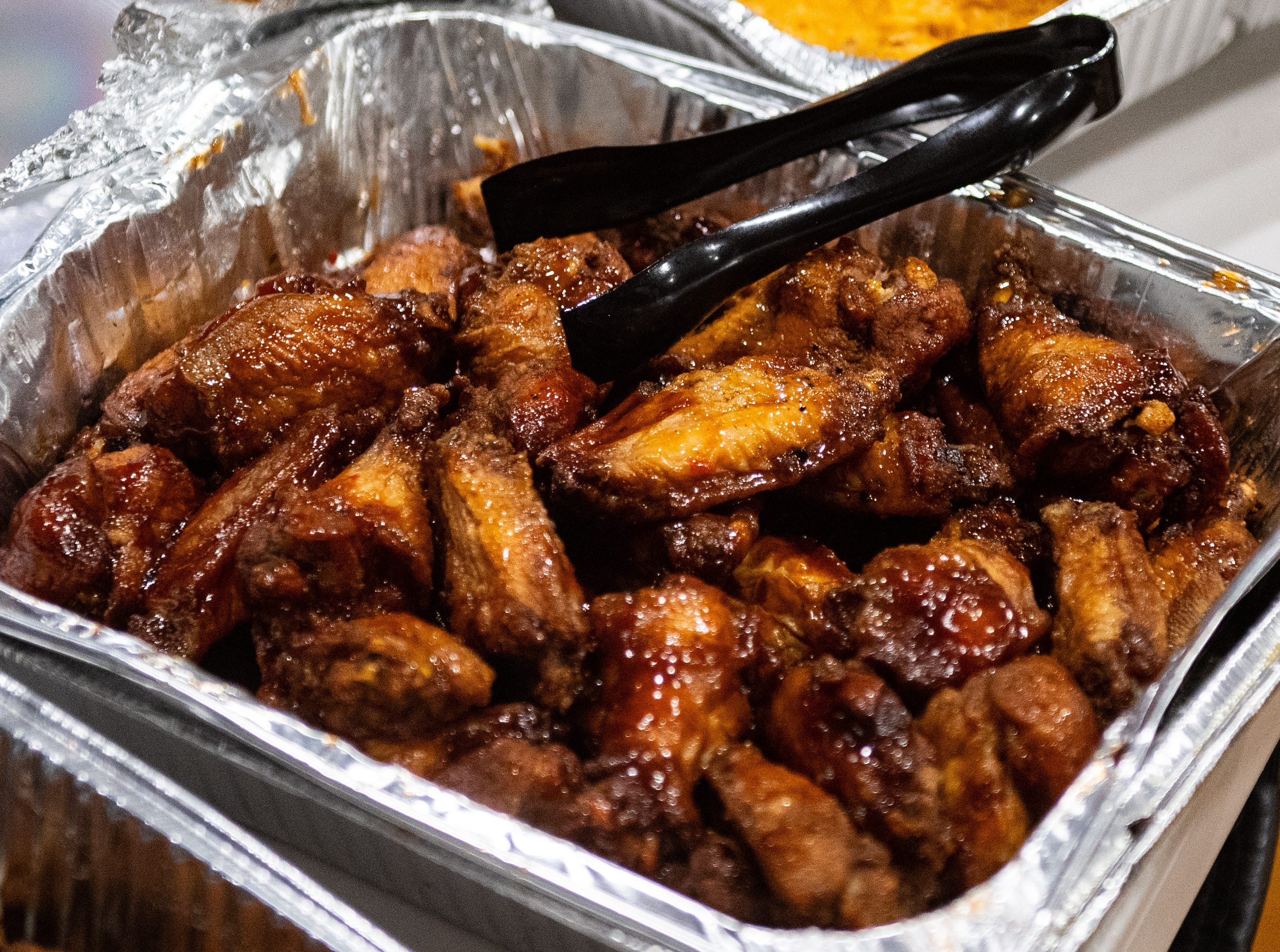 The grand opening party featured a variety of foods including barbecue wings, fried chicken and strawberries, March 7, 2019.