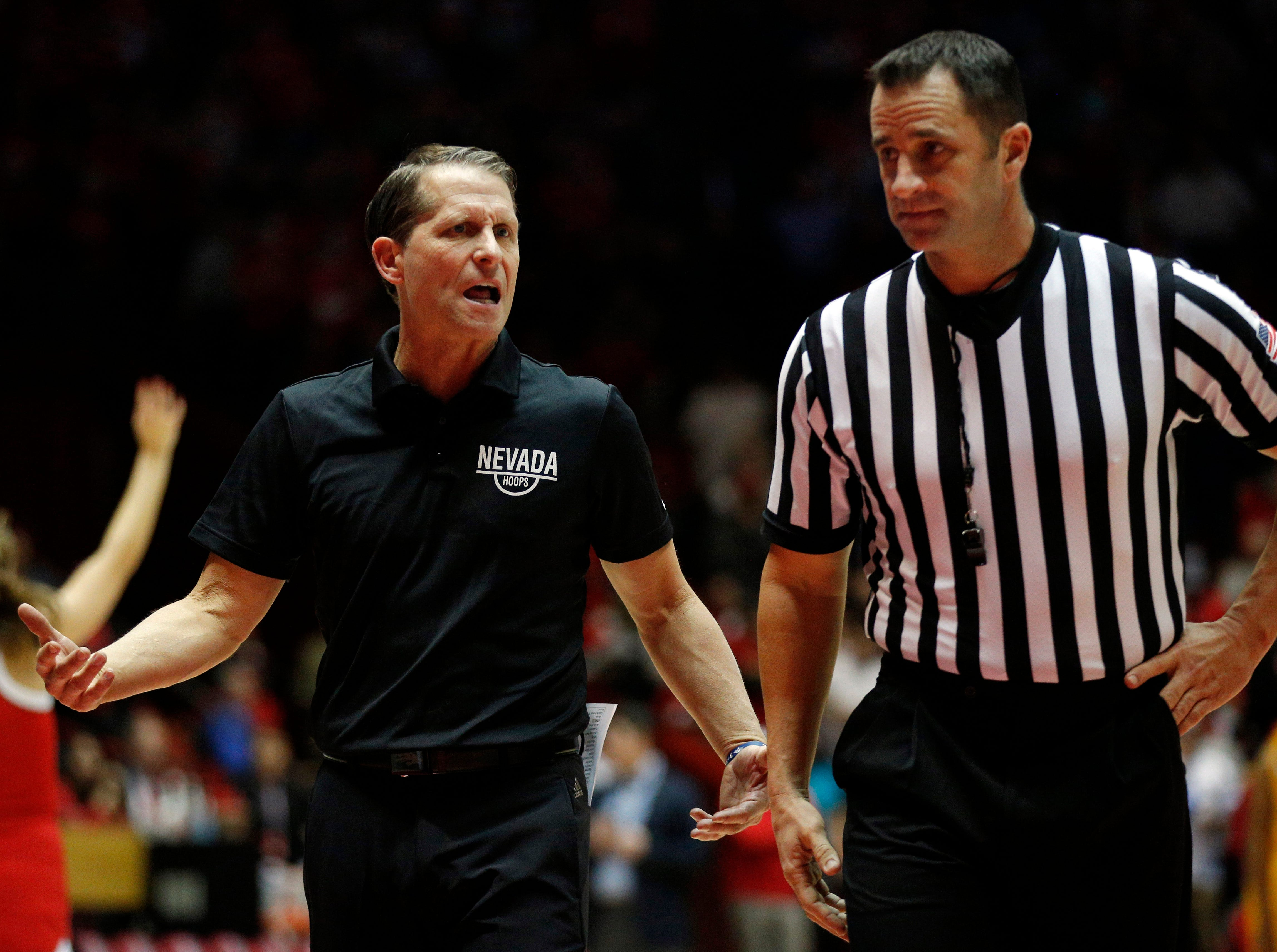 Nevada head coach Eric Musselman, left, argues with official D.G. Nelson during the second half of an NCAA college basketball game against New Mexico in Albuquerque, N.M., Saturday, Jan. 5, 2019. (AP Photo/Andres Leighton)