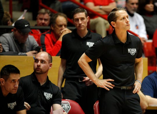 Nevada head coach Eric Musselman, right, reacts from the sideline during the second half of an NCAA college basketball game against New Mexico in Albuquerque, N.M., Saturday, Jan. 5, 2019. New Mexico won 85-58. (AP Photo/Andres Leighton)