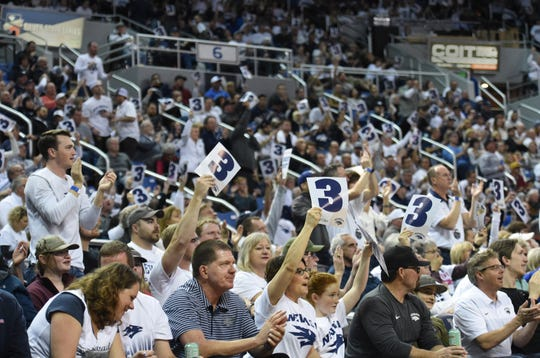 Nevada fans cheer after a Wolf Pack 3-point shot earlier this season at Lawlor Events Center.