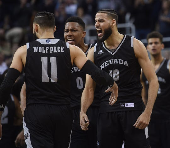 Nevada seniors (from left) Cody Martin, Tre'Shawn Thurman and Caleb Martin will try to bring a third straight Mountain West title to Reno on Saturday.