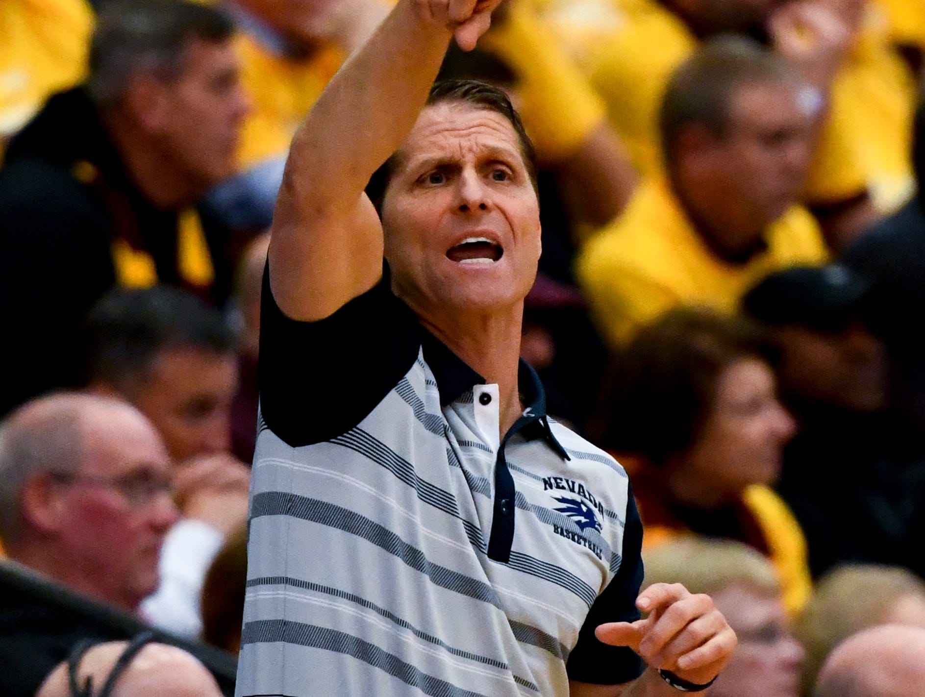 Nevada head coach Eric Musselman directs his team against Loyola of Chicago during the first half of an NCAA college basketball game against Nevada in Chicago, Tuesday, Nov. 27, 2018. (AP Photo/Matt Marton)