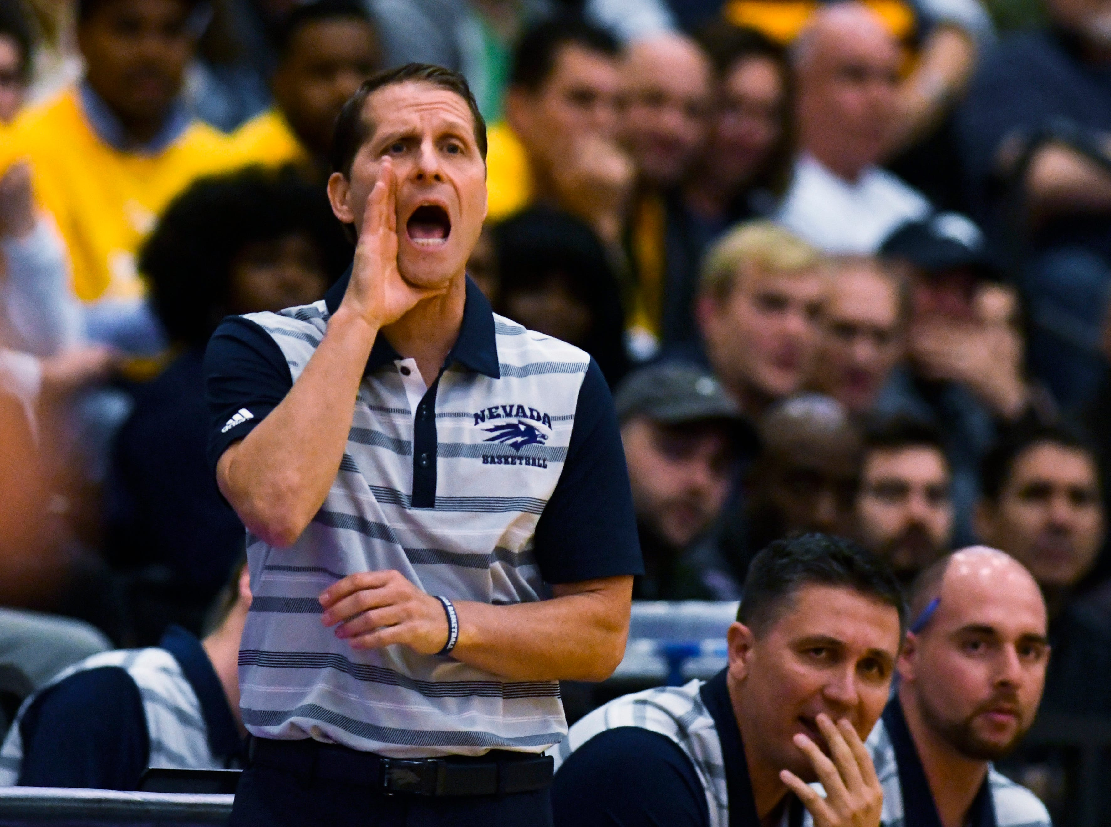 Nevada head coach Eric Musselman directs his team during the first half of an NCAA college basketball game against Loyola of Chicago in Chicago, Tuesday, Nov. 27, 2018. (AP Photo/Matt Marton)