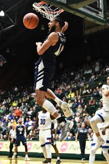 Nevada forward Caleb Martin finishes off a basket against the Colorado State Rams at Moby Arena.