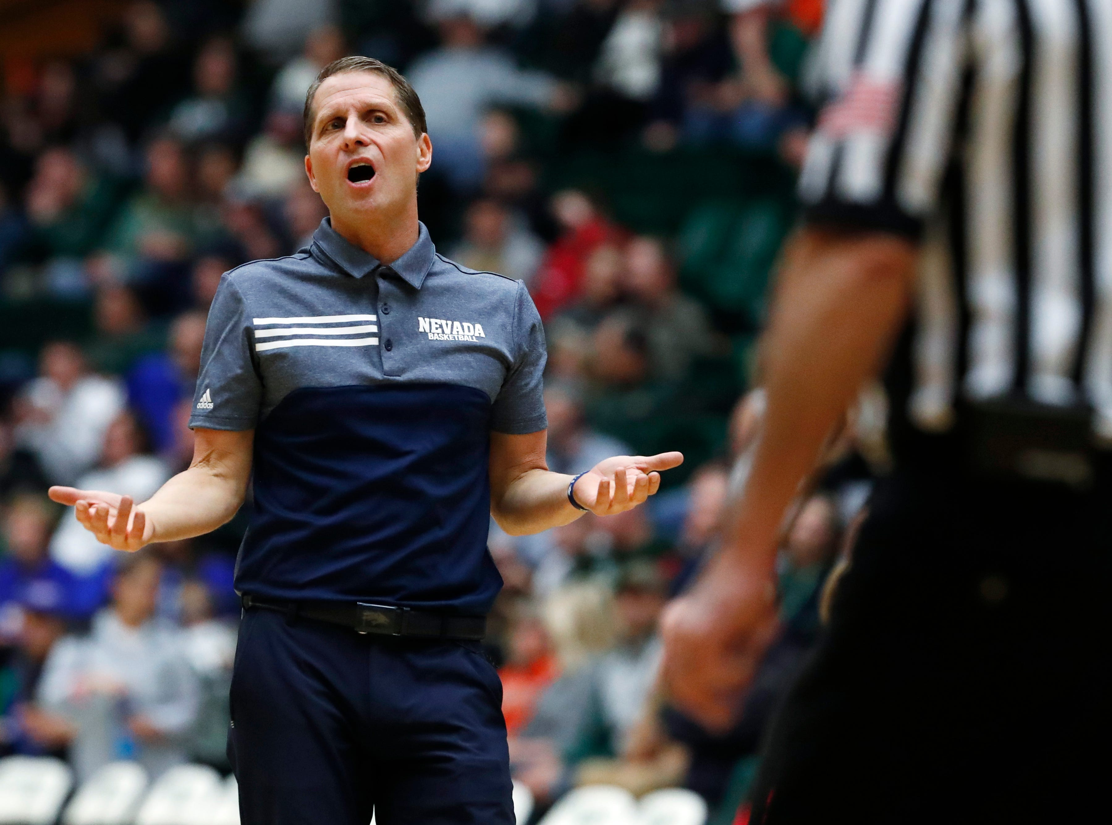Nevada coach Eric Musselman argues for a call with a referee during the second half of the team's NCAA college basketball game against Colorado State on Wednesday, Feb. 6, 2019, in Fort Collins, Colo. Nevada won 98-82. (AP Photo/David Zalubowski)