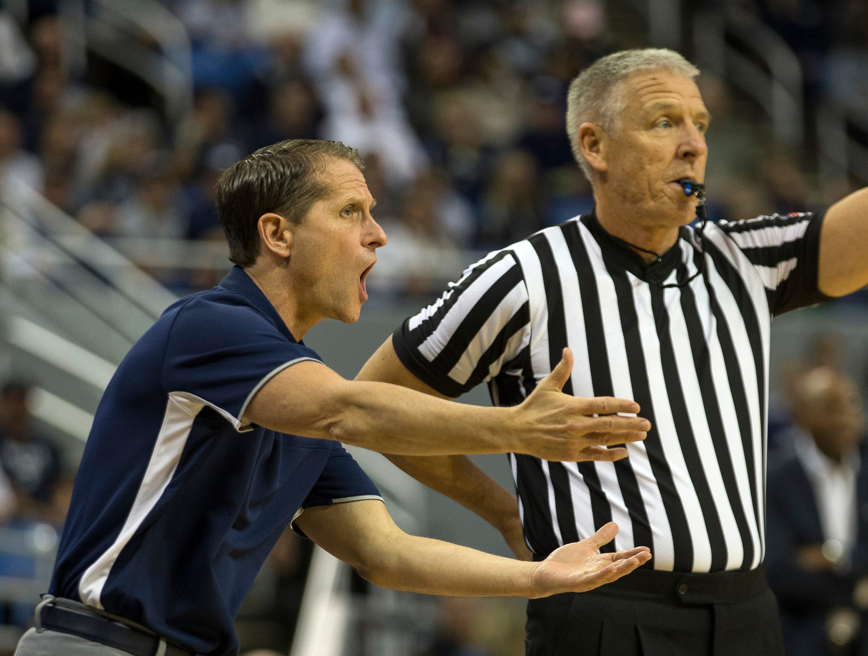 Nevada Nevada head coach Eric Musselman talks with a referee in the first half of an NCAA college basketball game against Little Rock in Reno, Nev., Friday, Nov. 16, 2018. (AP Photo/Tom R. Smedes)