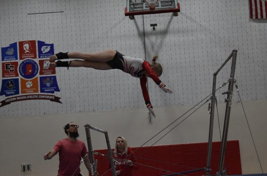 Lizzy Ruger competes on bars.