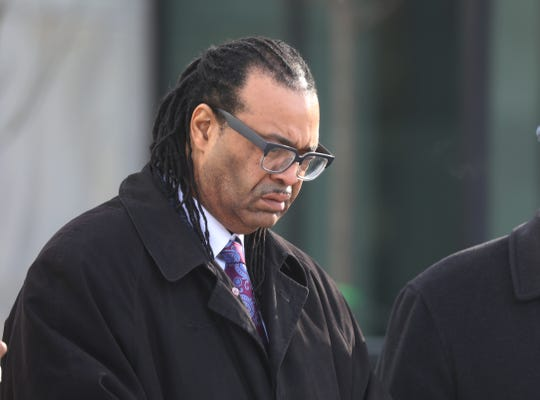 Adam McFadden leaves federal court with his attorney, Joseph Damelio, in the file photo from March 2019.