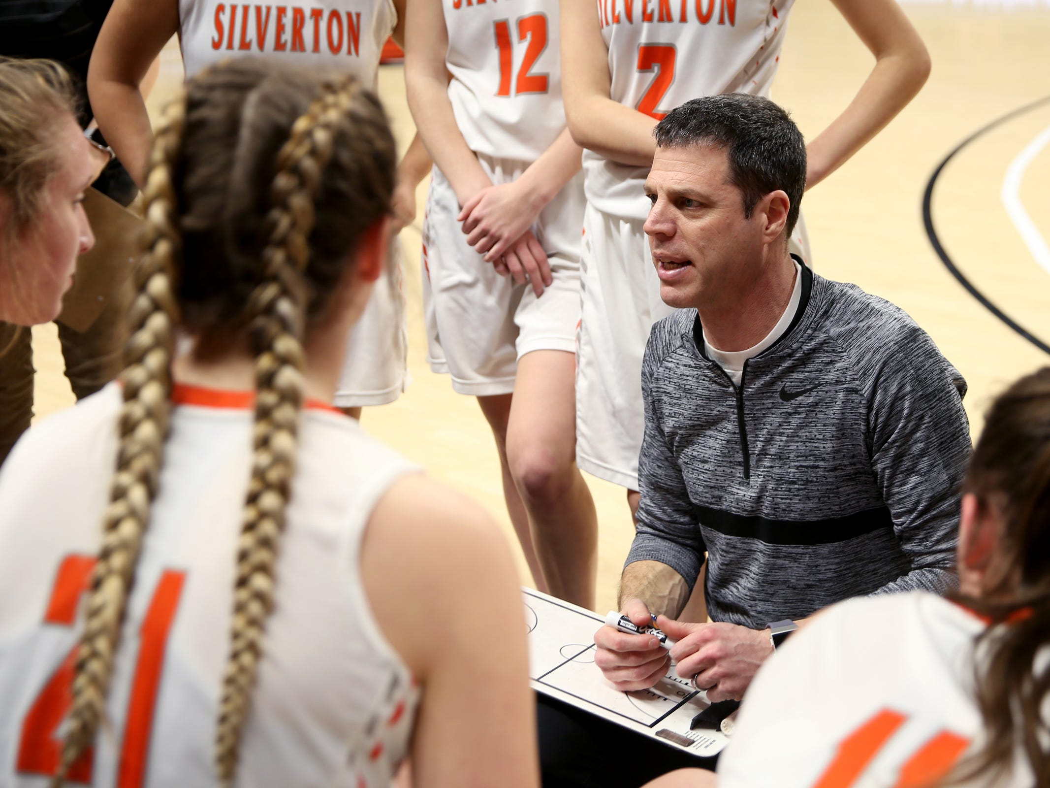 Silverton head coach Tal Wold talks to his team during a break in the second half of the La Salle Prep vs. Silverton girls basketball game in the OSAA Class 5A quarterfinals at Oregon State University in Corvallis on Thursday, March 7, 2019. La Salle Prep won the game 57-46.