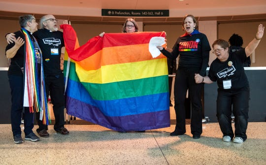 Protesters objecting to the adoption of a platform rejecting same-sex marriage and ordination of LGBT clergy gather outside the United Methodist Church's 2019 Special Session of the General Conference in St. Louis, Mo., Tuesday, Feb. 26, 2019.