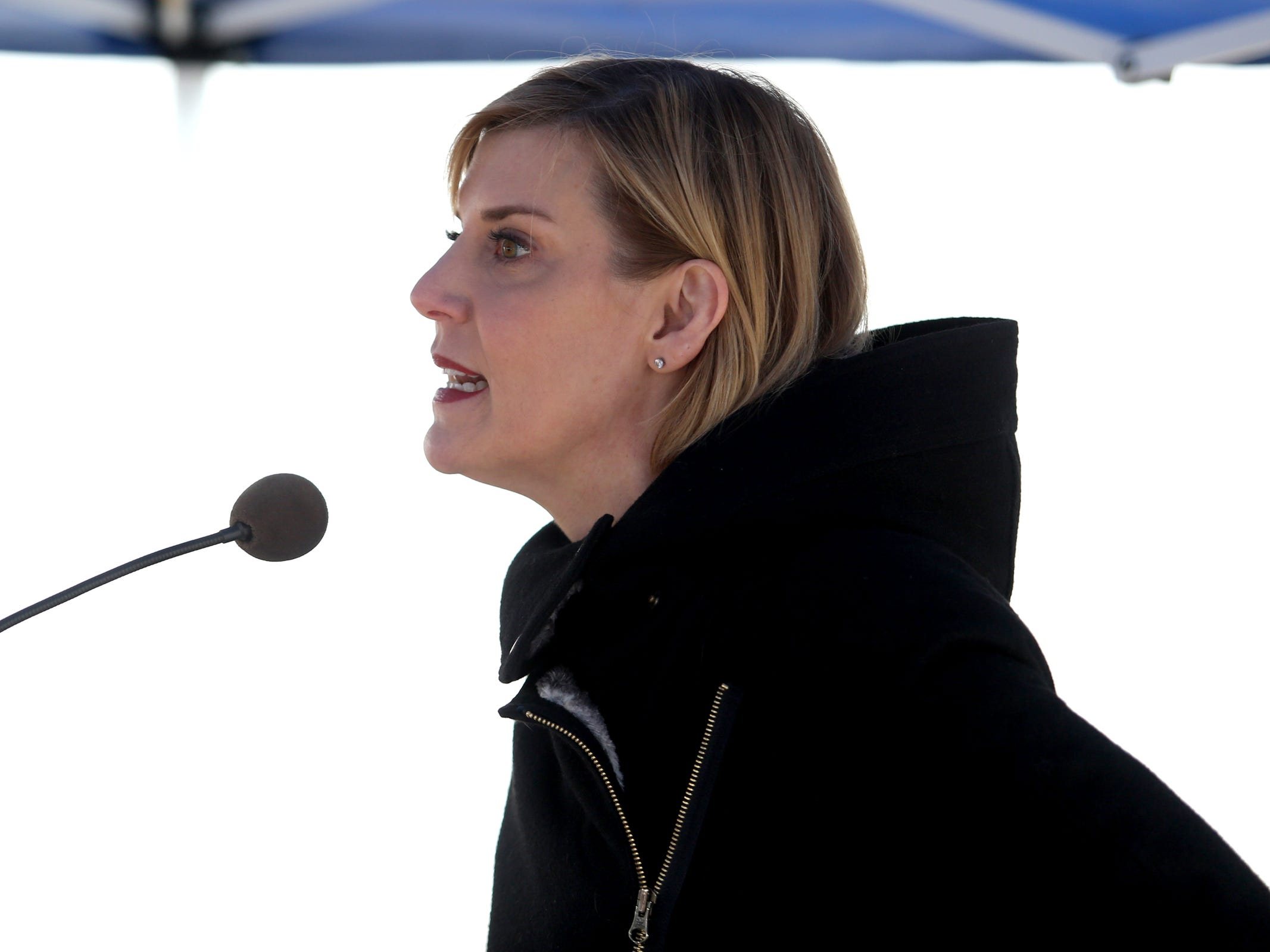 Rep. Jennifer Williamson, D-Portland, the House Majority Leader, speaks during a demonstration for International Women's Day at the Oregon State Capitol in Salem on Friday, March 8, 2019. Many during the rally voiced their support for a state-run family and medical leave insurance program in Oregon.