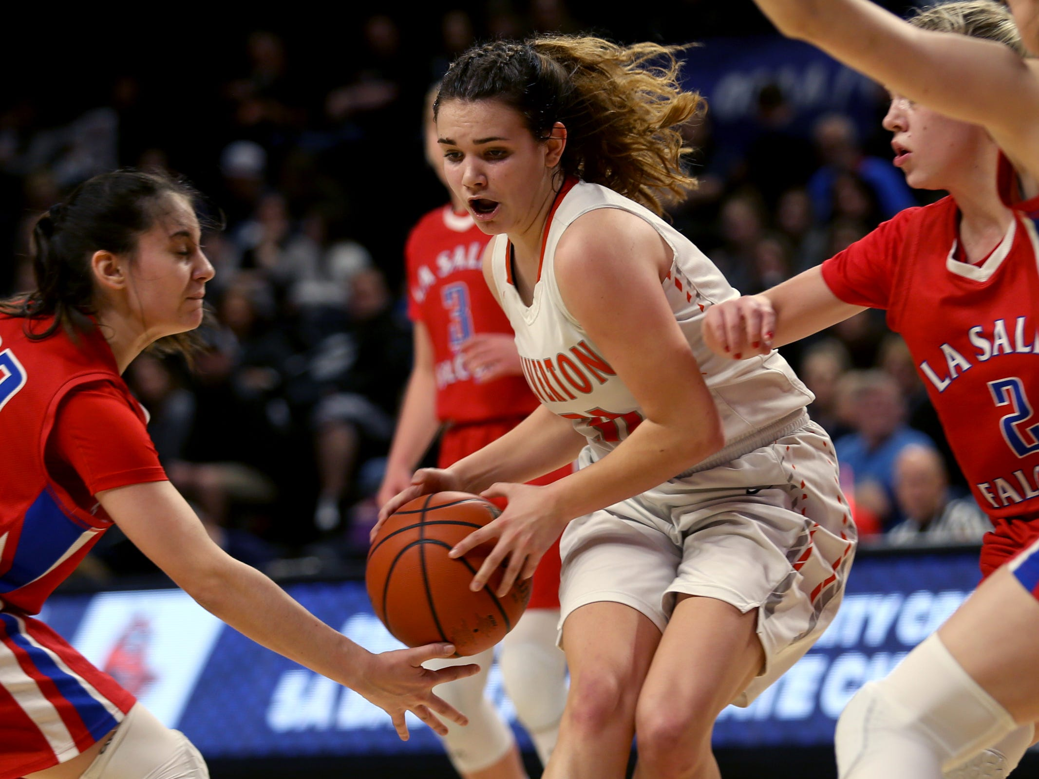 Silverton's Josslyn Ames (31)  fights to keep control of the ball in the first half of the La Salle Prep vs. Silverton girls basketball game in the OSAA Class 5A quarterfinals at Oregon State University in Corvallis on Thursday, March 7, 2019. La Salle Prep won the game 57-46.