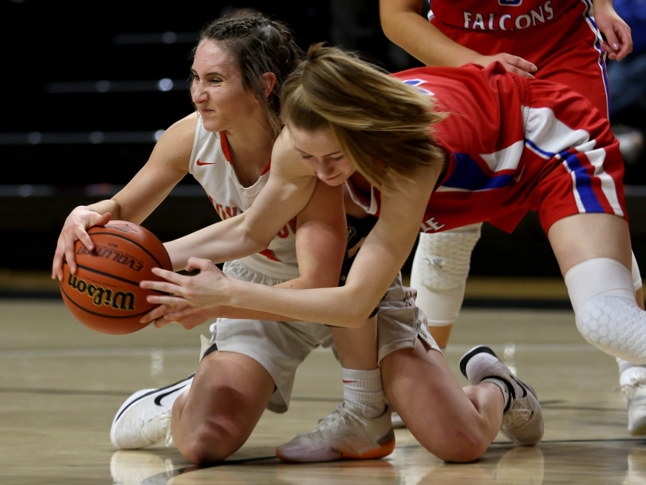Silverton's Jori Paradis (1) and La Salle Prep's Lindsay Drango (4) fight for the ball on the floor in the second half of the La Salle Prep vs. Silverton girls basketball game in the OSAA Class 5A quarterfinals at Oregon State University in Corvallis on Thursday, March 7, 2019. La Salle Prep won the game 57-46.