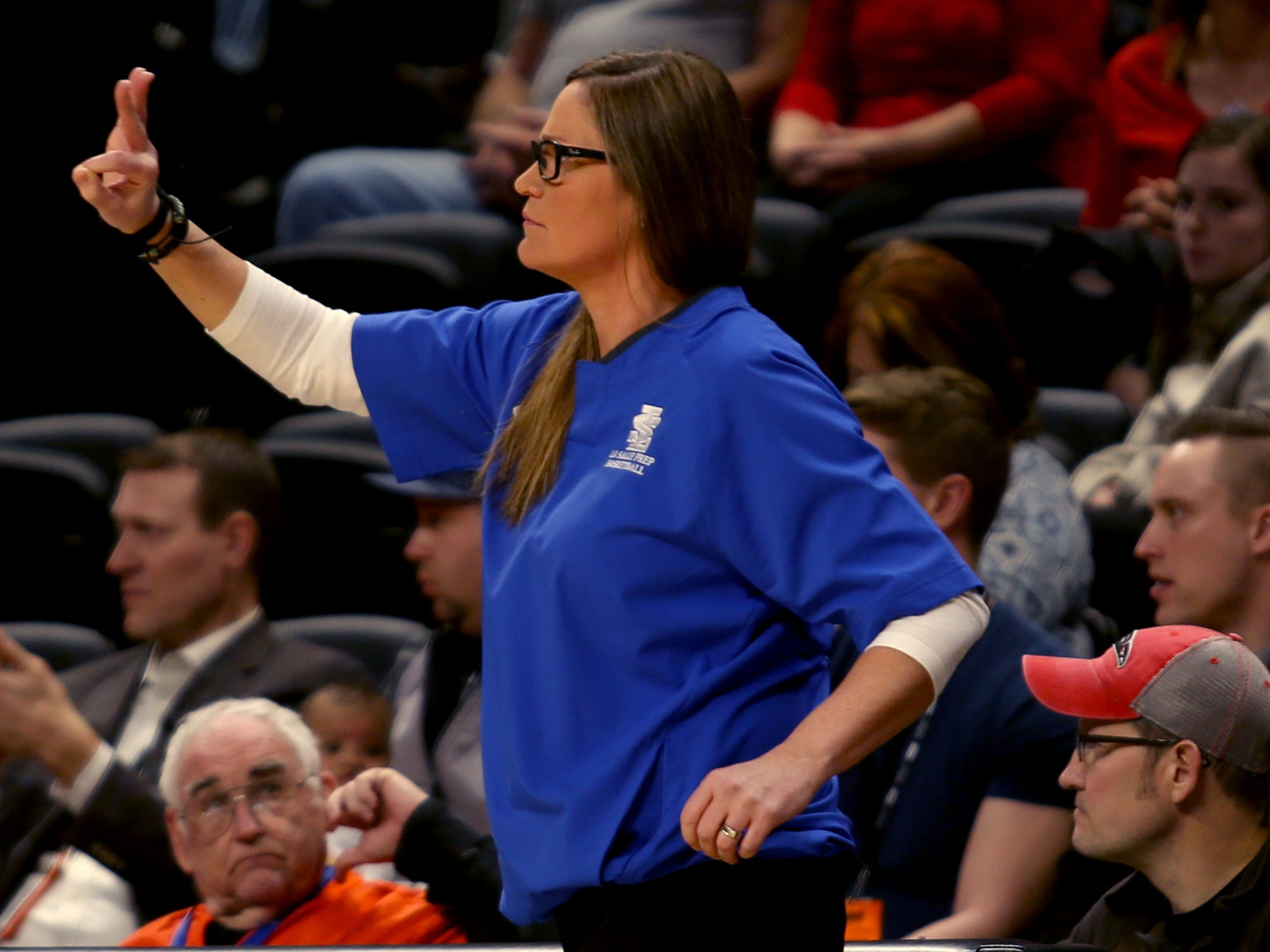 La Salle Prep head coach Kelli Wedin gives a signal to her team in the first half of the La Salle Prep vs. Silverton girls basketball game in the OSAA Class 5A quarterfinals at Oregon State University in Corvallis on Thursday, March 7, 2019. La Salle Prep won the game 57-46.