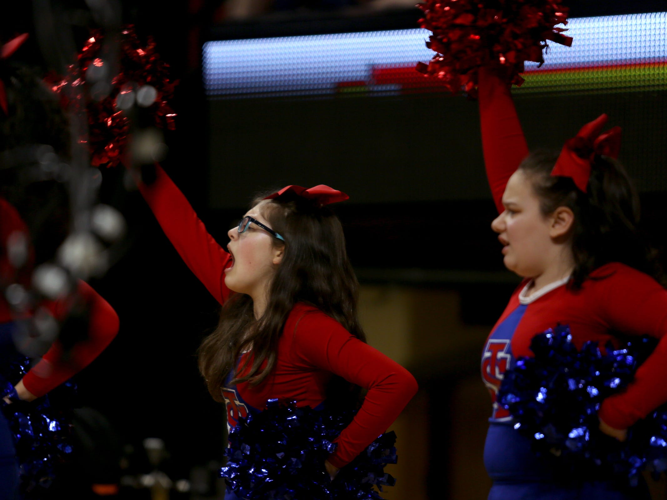 La Salle Prep cheerleaders perform in the first half of the La Salle Prep vs. Silverton girls basketball game in the OSAA Class 5A quarterfinals at Oregon State University in Corvallis on Thursday, March 7, 2019. La Salle Prep won the game 57-46.
