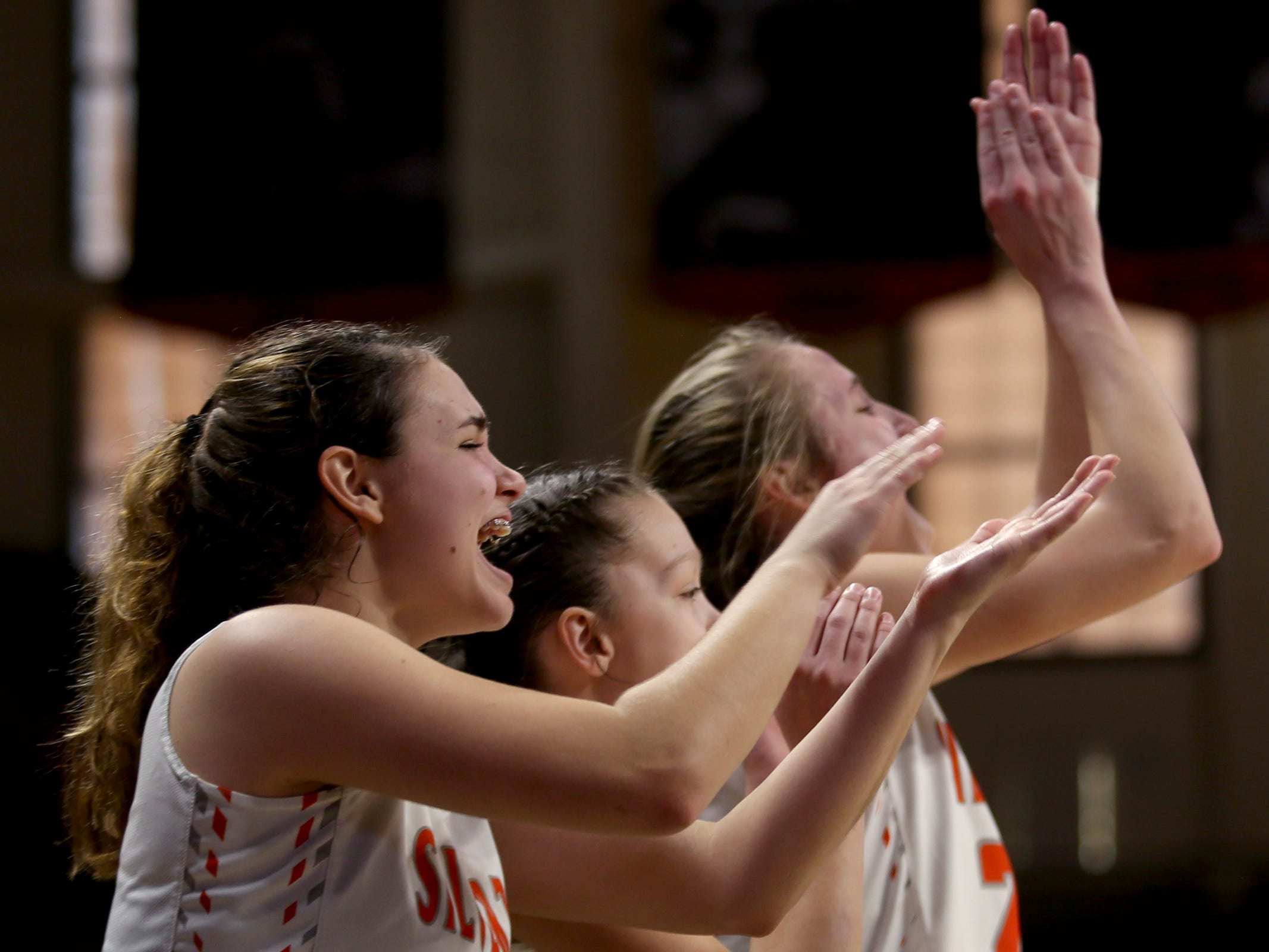 The Silverton bench celebrates a play in the second half of the La Salle Prep vs. Silverton girls basketball game in the OSAA Class 5A quarterfinals at Oregon State University in Corvallis on Thursday, March 7, 2019. La Salle Prep won the game 57-46.