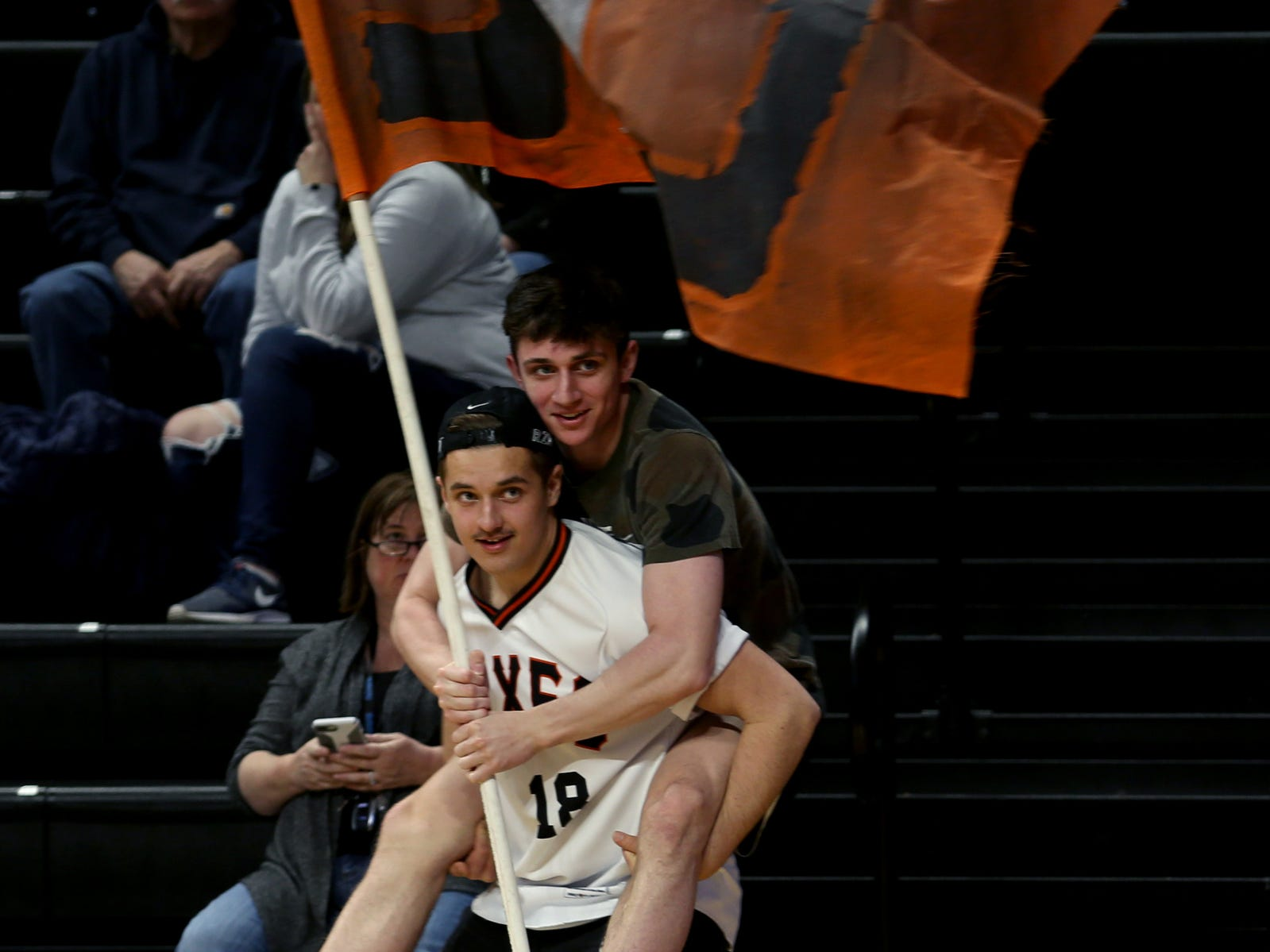 Silverton fans celebrate a basket in the second half of the La Salle Prep vs. Silverton girls basketball game in the OSAA Class 5A quarterfinals at Oregon State University in Corvallis on Thursday, March 7, 2019. La Salle Prep won the game 57-46.