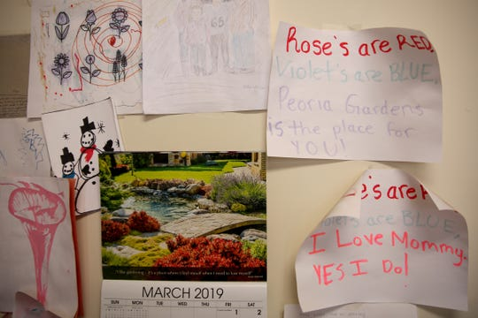 "Drawings by employees' children hang in the office at Peoria Gardens near Albany on Friday, March 8, 2019. The small business already offers its 26 full-time employees paid parental leave, but owner Ben Verhoeven says a state-run program would be less difficult than trying to provide the same level of protection to his employees with a standalone plan. ""It would be infinitely easier and infinitely less expensive,"" he said."