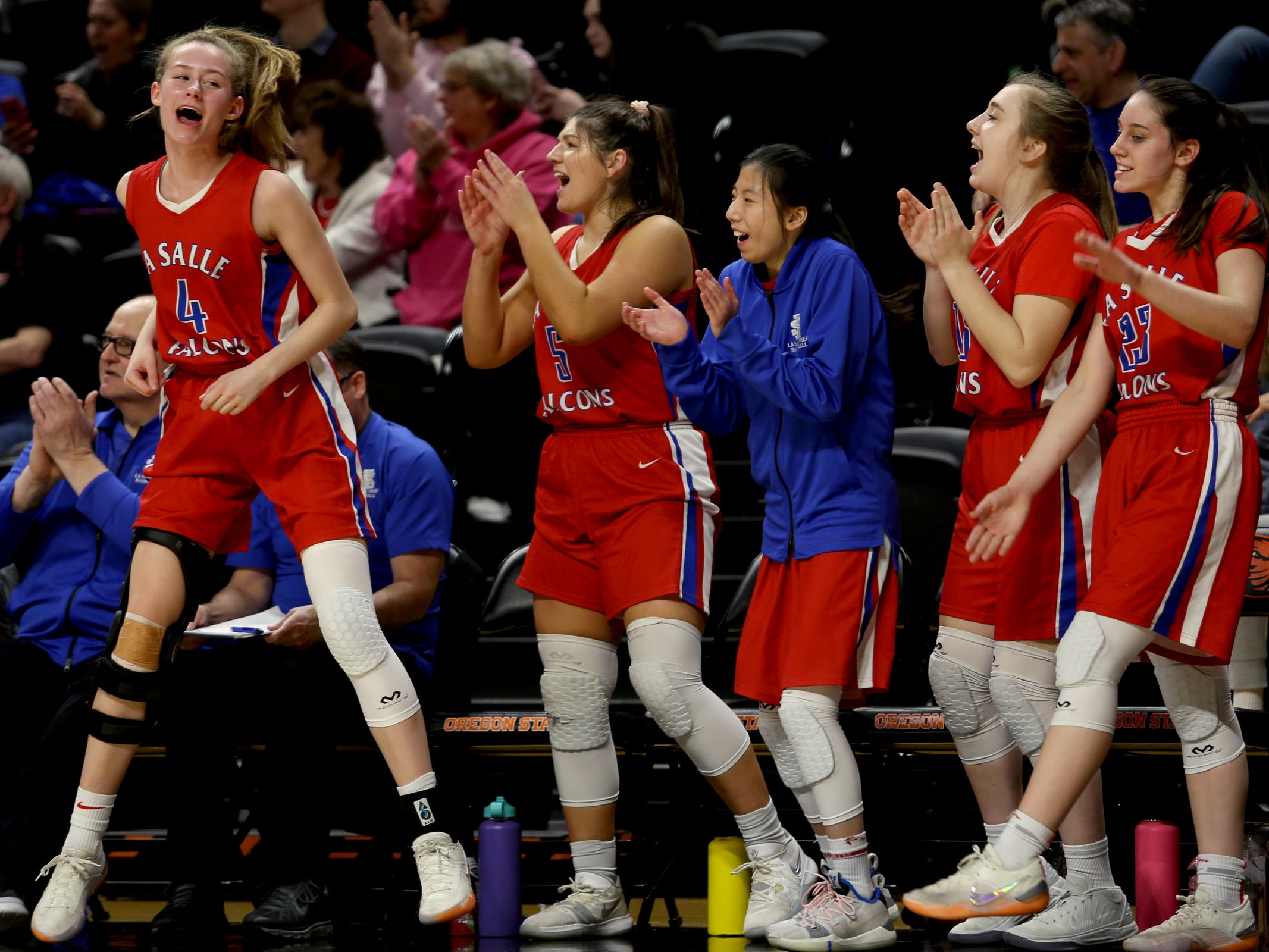 The La Salle Prep bench celebrates a play in the first half of the La Salle Prep vs. Silverton girls basketball game in the OSAA Class 5A quarterfinals at Oregon State University in Corvallis on Thursday, March 7, 2019. La Salle Prep won the game 57-46.