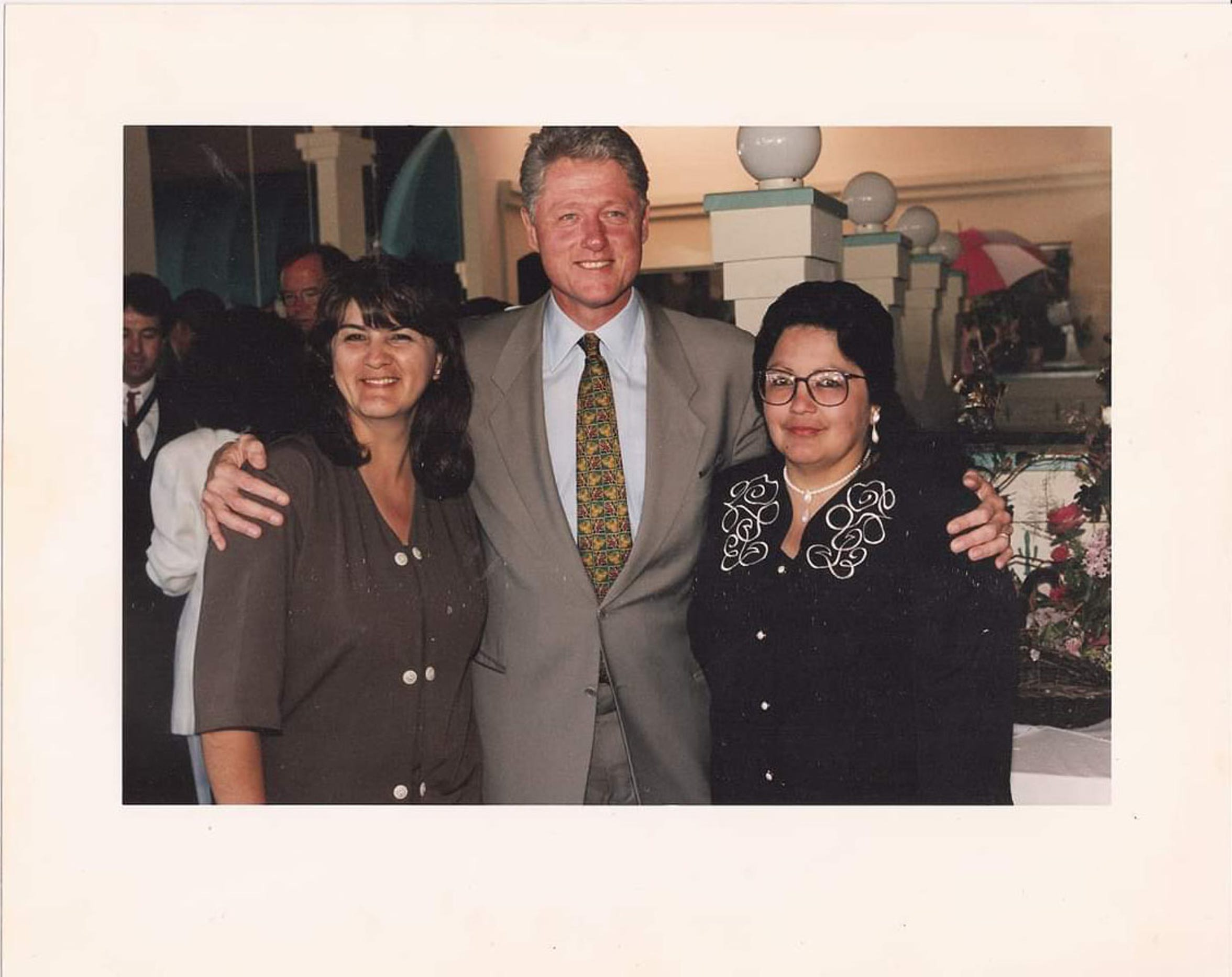 Gloria Torrez (left) and Angie Morfin (right), who started Mothers Against Violence, pose with President Bill Clinton during his tenure in the White House.