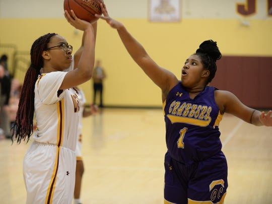 Washington High School's Dezmiya Ireland takes a shot against Crisfield's Evy Potter on Thursday, March 7, 2019.
