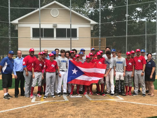Players from a Puerto Rican team pose with Eastern Shore FORCE baseball members during a 2018 tournament in Maryland.