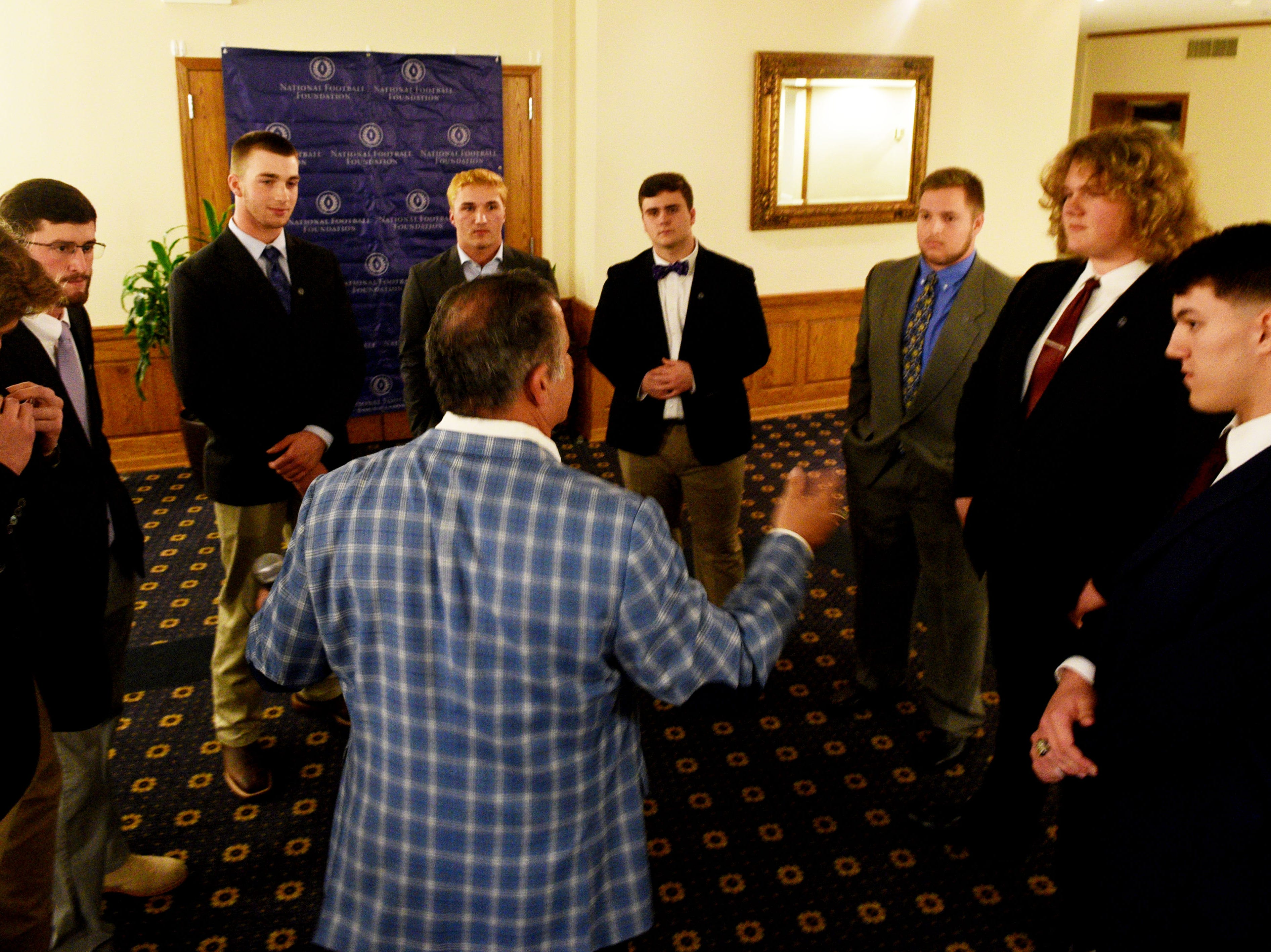 Sam McNaughton Chapter of the National Football Foundation honors 9 area athletes, Tag Rome and Brandon Landry during the Thursday evening Scholar Athlete Awards Banquet at the East Ridge Country Club.