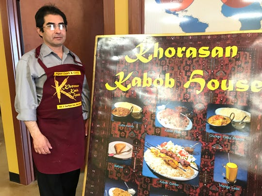 Khorasan Kabob House owner Arian Wisaal poses for portrait at his restaurant on Garfield Avenue. He plans to close his restaurant next week and re-open in about a month at a new location.