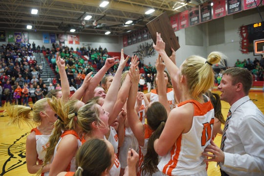 Lennox celebrates after their win against Sioux Falls Christian Thursday, March 7, at Brandon Valley High School in Brandon Valley.