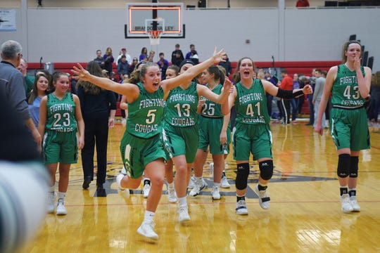 McCook Central/Montrose's McKenna Kranz runs towards the student section after their win against Beresford Thursday, March 7, at Brandon Valley High School in Brandon Valley.
