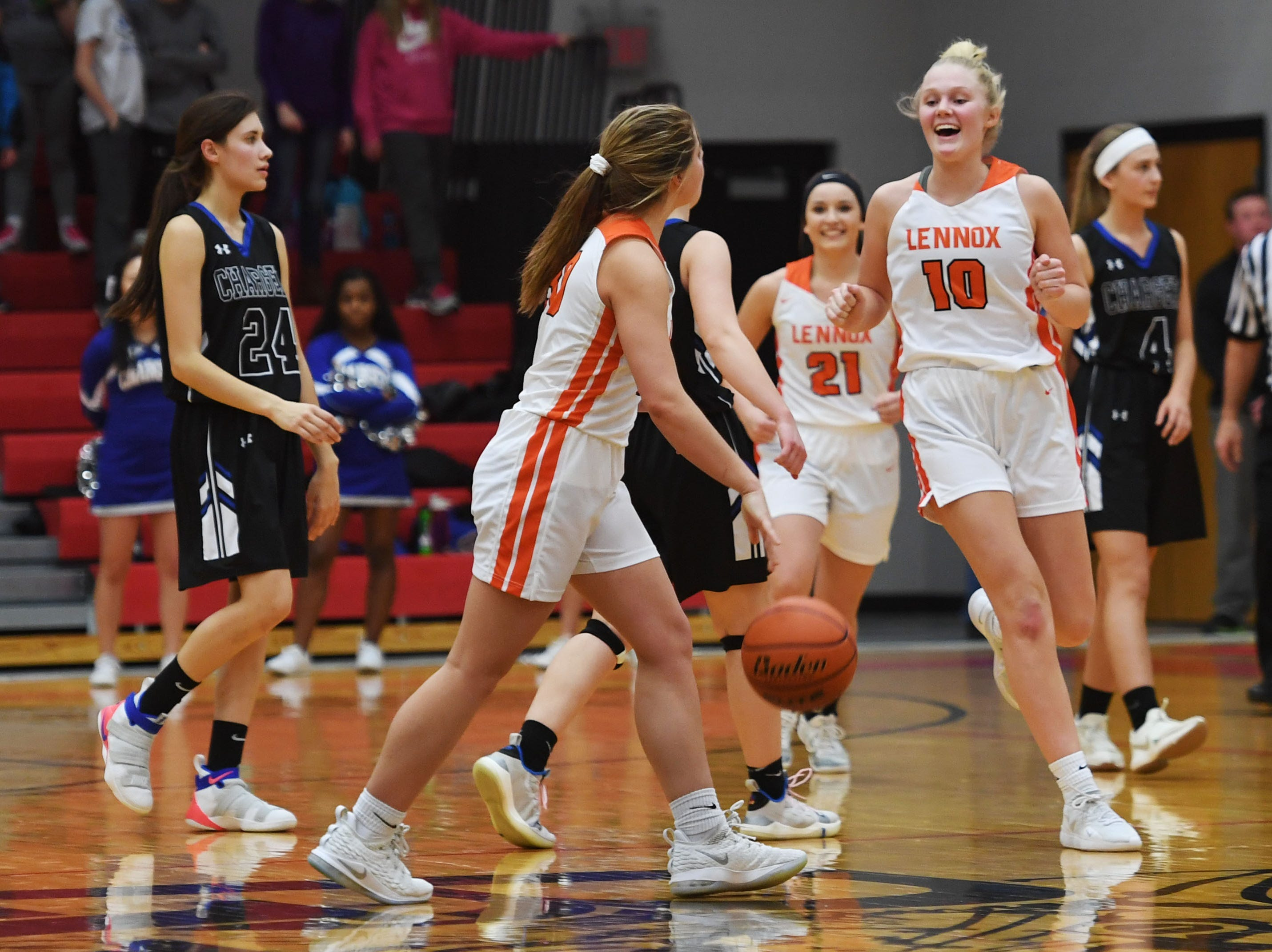 Lennox begins to celebrate at the end of the fourth period after their win against Sioux Falls Christian Thursday, March 7, at Brandon Valley High School in Brandon Valley.