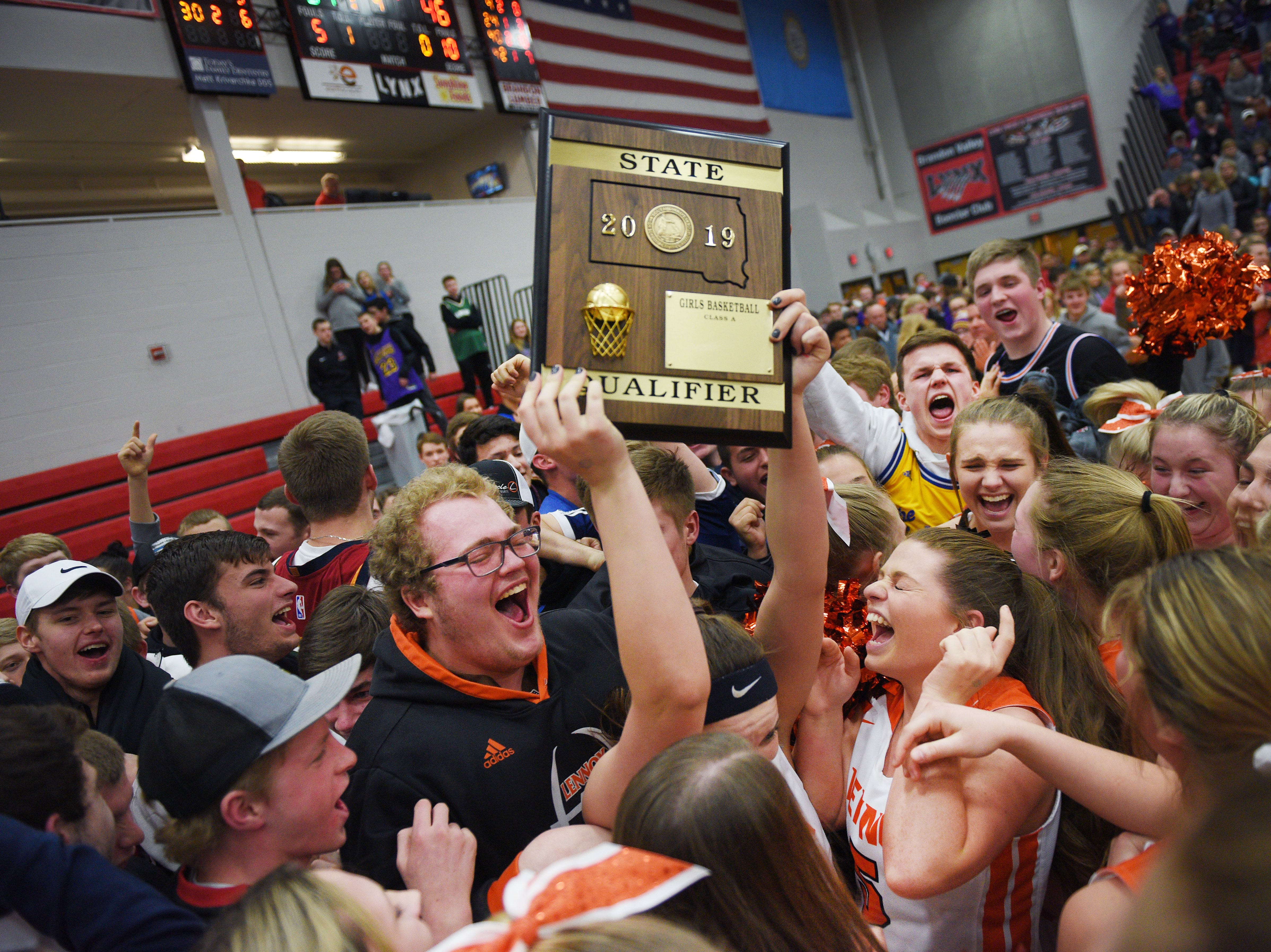 Lennox celebrates their win against Sioux Falls Christian in the Class A girls SoDak 16 Thursday, March 7, at Brandon Valley High School in Brandon Valley.