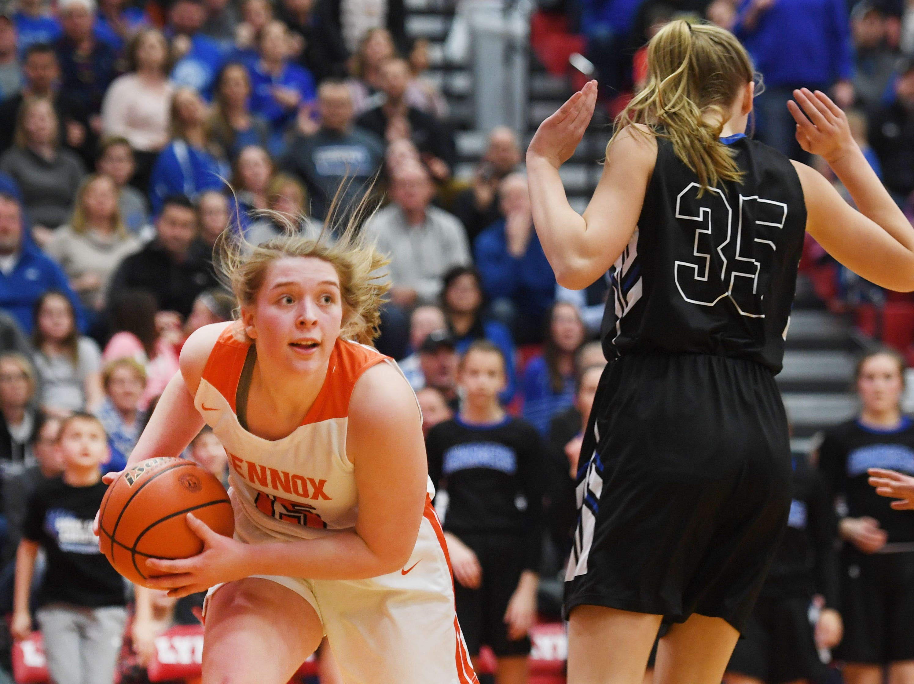 Lennox's Mara Hinker goes against Sioux Falls Christian under the net during the game Thursday, March 7, at Brandon Valley High School in Brandon Valley.