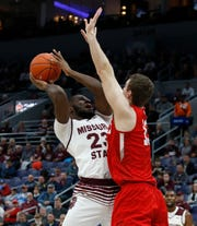 Missouri State's Kabir Mohammed (23) puts up a shot under pressure from Bradley, Friday, March 8, 2019, at the Enterprise Center in St. Louis.