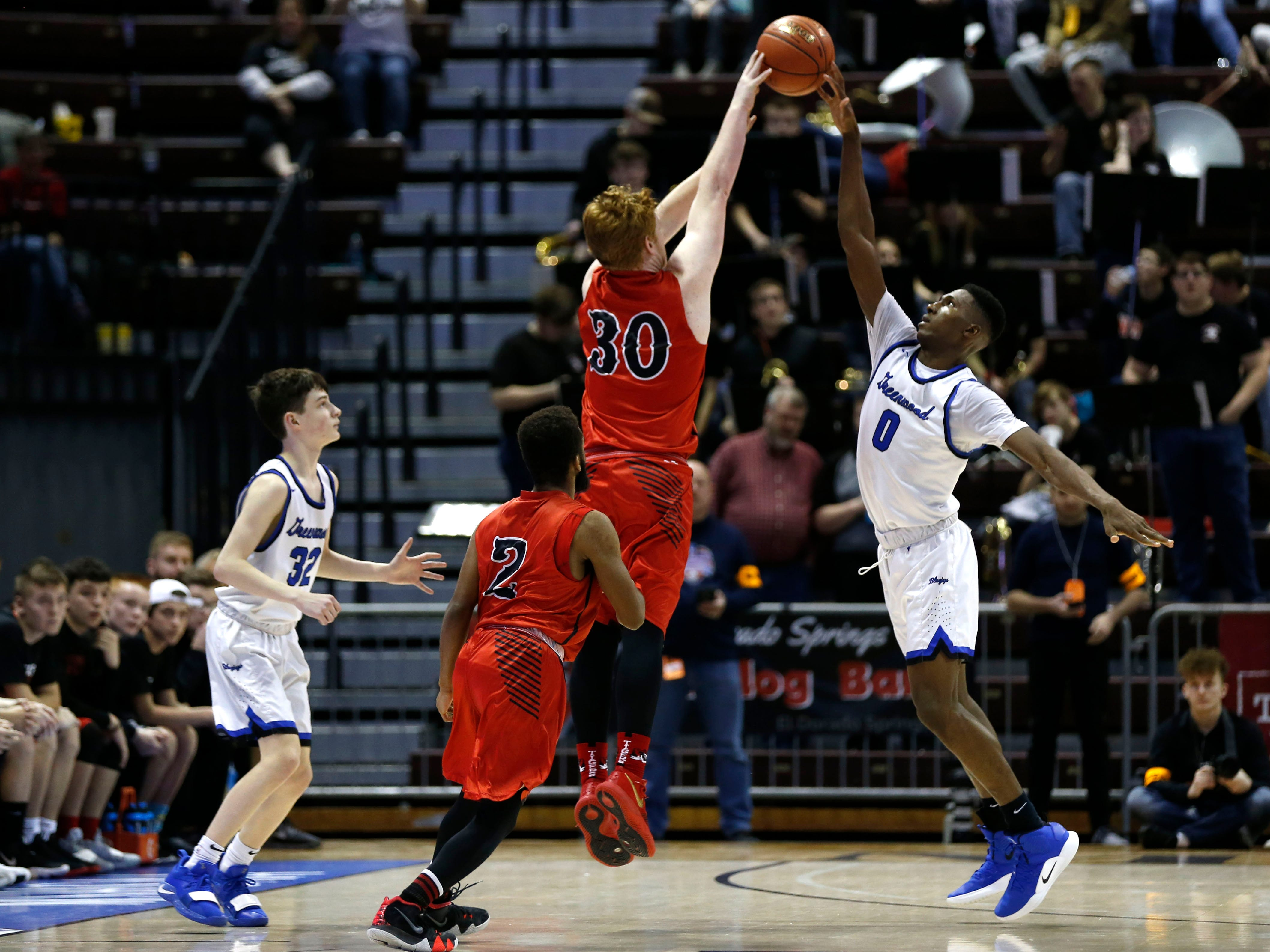 Greenwood's Aminu Mohammed tips a shot by Plattsburg's Garrett Stephens in the final seconds of the game giving the Blue Jays the win over the Tigers during the semifinal round of Class 2 state basketball at JQH Arena on Friday, March 8, 2019.