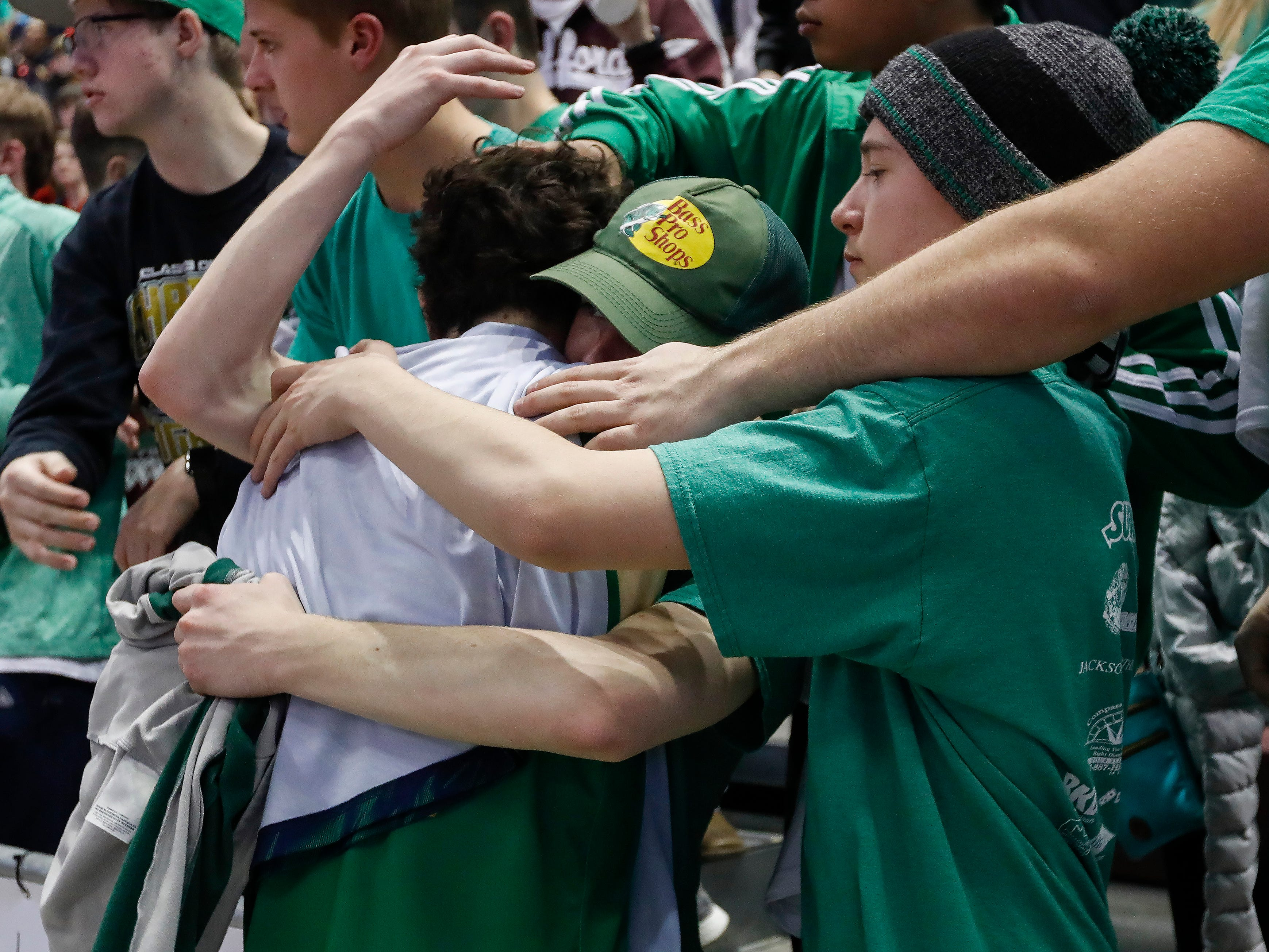 Springfield Catholic fans console Michael Manzardo after the Irish's 69-59 loss to Vashon in the Class 3 state championship game at JQH Arena on Friday, March 8, 2019.