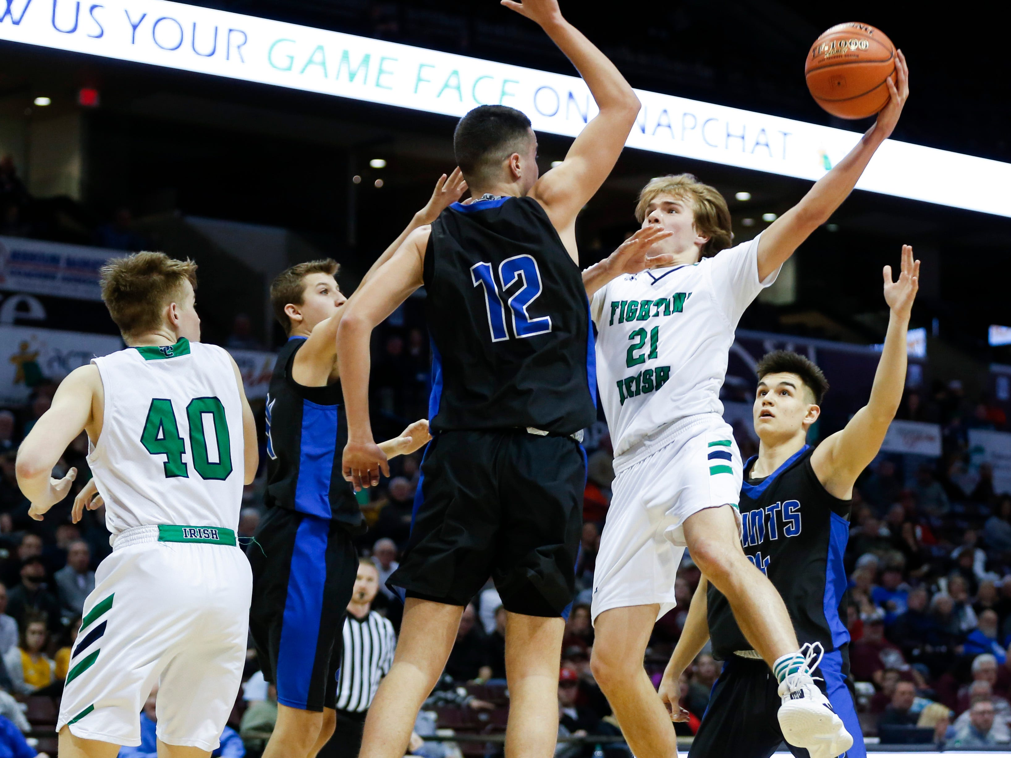 Springfield Catholic's Charlie O'Reilly attempts a field goal as St. Paul Lutheran's Vlado Vretenicic attempts to block the shot in the semifinal round of Class 3 state basketball at JQH Arena on Thursday, March 7, 2019