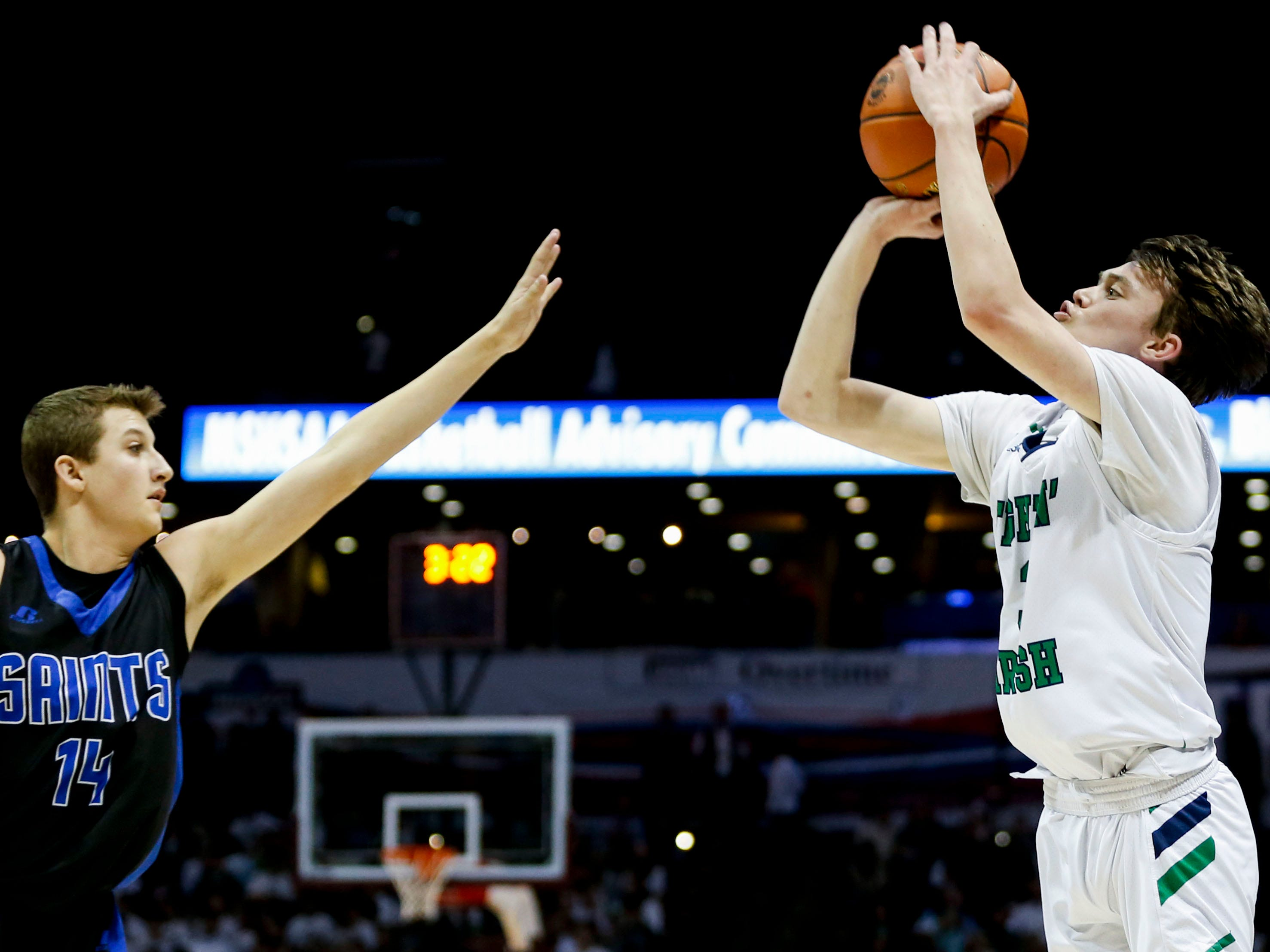 Springfield Catholic's Jake Branham shoots a field goal over St. Paul Lutheran's Justin Griffith in the semifinal round of Class 3 state basketball at JQH Arena on Thursday, March 7, 2019.